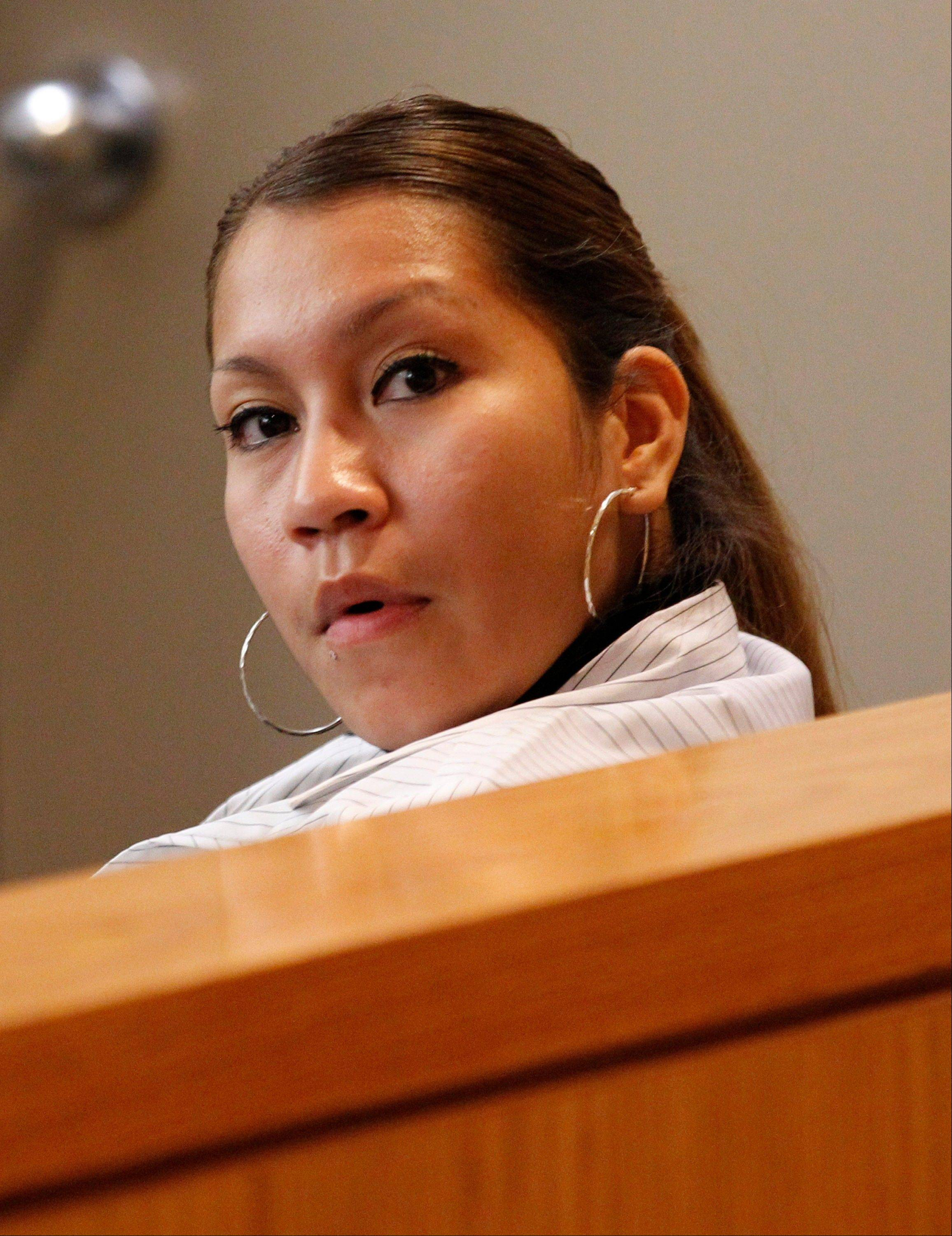 Elizabeth Escalona, 23, sits in a courtroom Monday during a sentencing hearing in Dallas. Escalona pleaded guilty in July to injury to a child and is facing up to life in prison. A doctor has testified that the Texas mother glued her 2-year-old daughter's hands to a wall and beat the toddler so badly that she suffered significant brain trauma and bleeding inside her skull.
