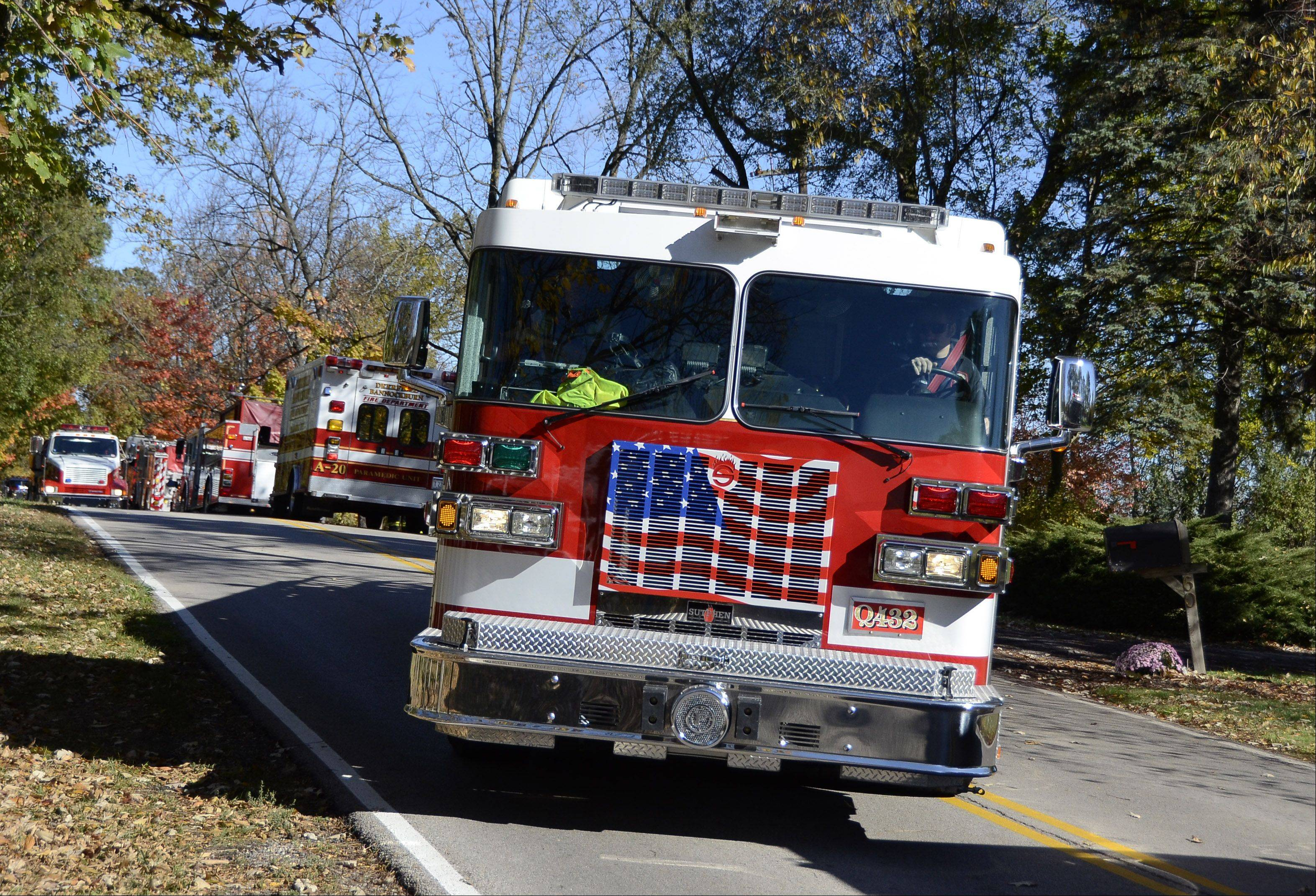 A fire truck blocks the road at Spring Creek and Ridge roads in Barrington Hills while crews battled a four-alarm fire Wednesday morning just north of the intersection.