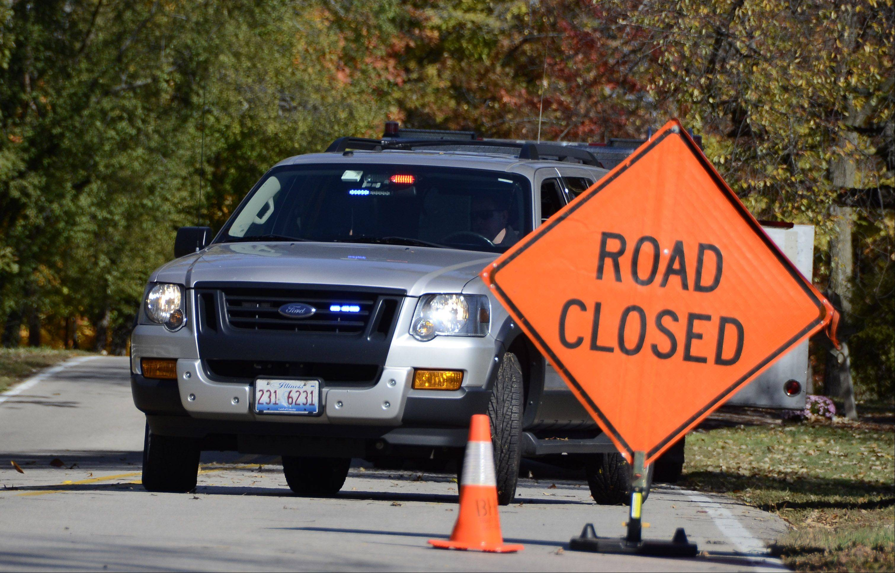 Spring Creek and Ridge roads in Barrington Hills were blocked this morning while fire crews battled a four-alarm blaze just north of the intersection.