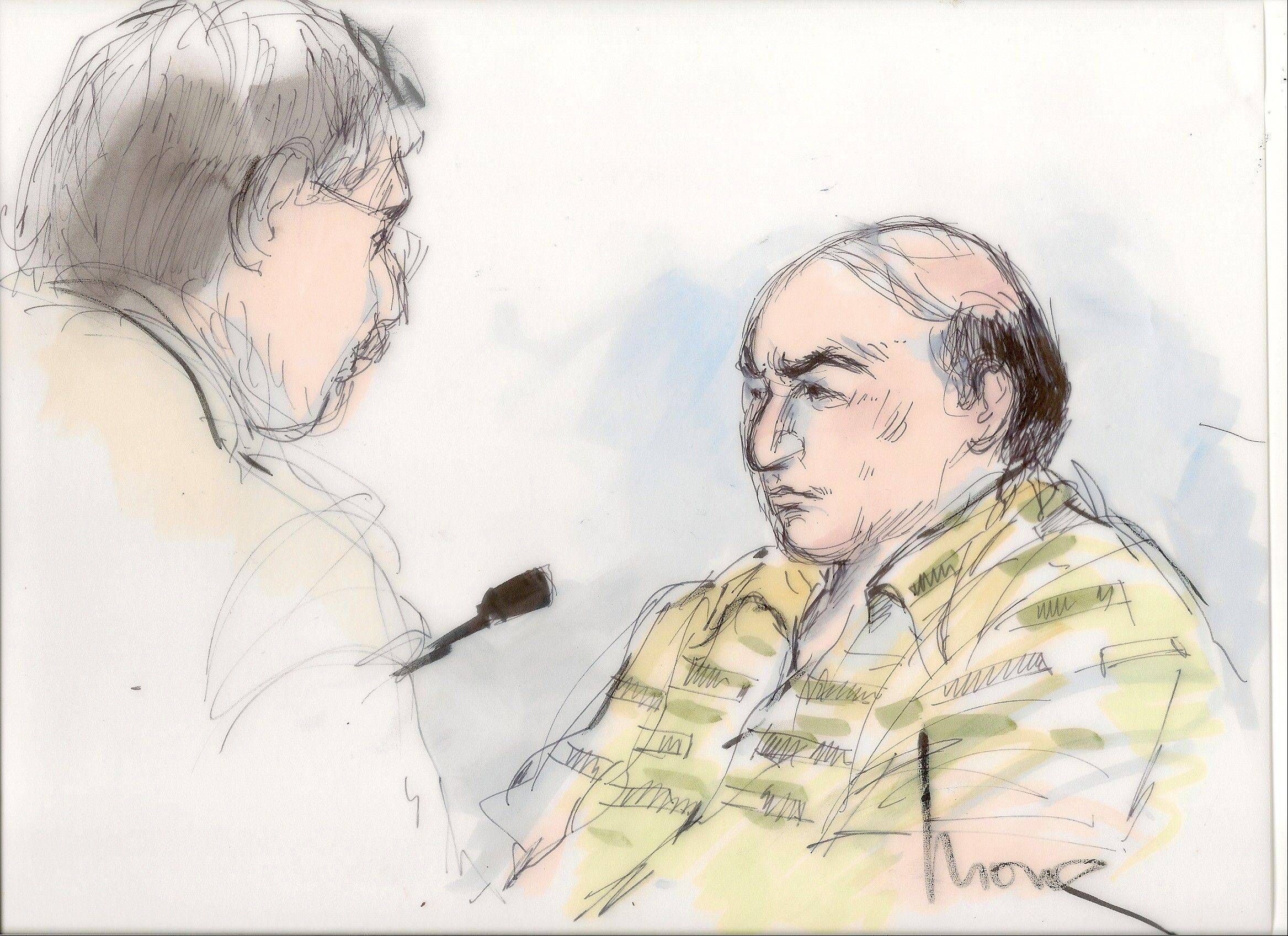 This file courtroom sketch shows Mark Basseley Youssef, right, talking with his attorney Steven Seiden in court. Youssef, who was behind an anti-Muslim film that sparked violence in the Middle East, is expected to be asked by a judge Wednesday, Oct. 10, 2012, whether he violated his probation for a 2010 bank fraud conviction.