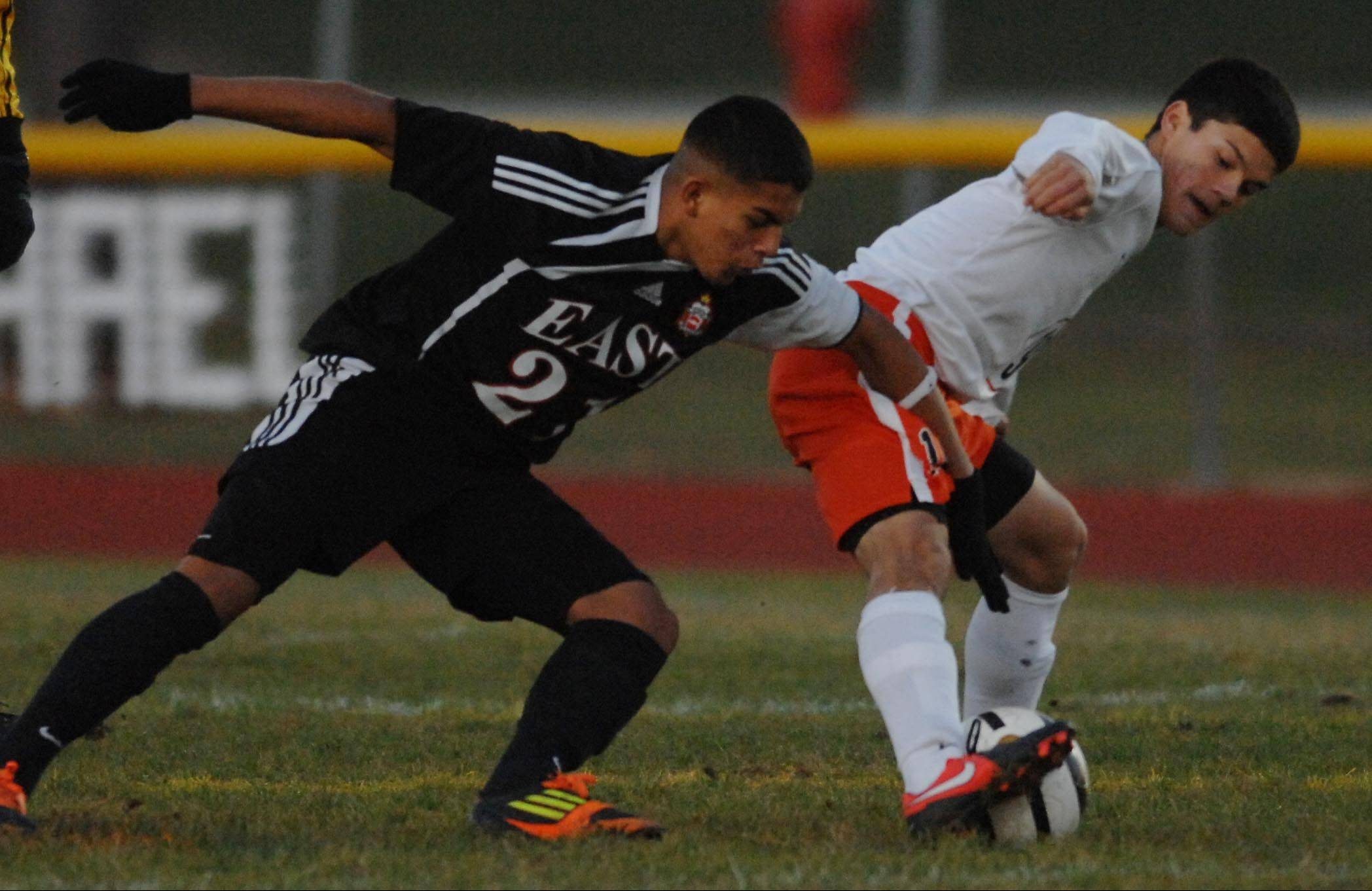 St. Charles East's Kevin Kurtz and East Aurora's Danny Miranda fight for possession.
