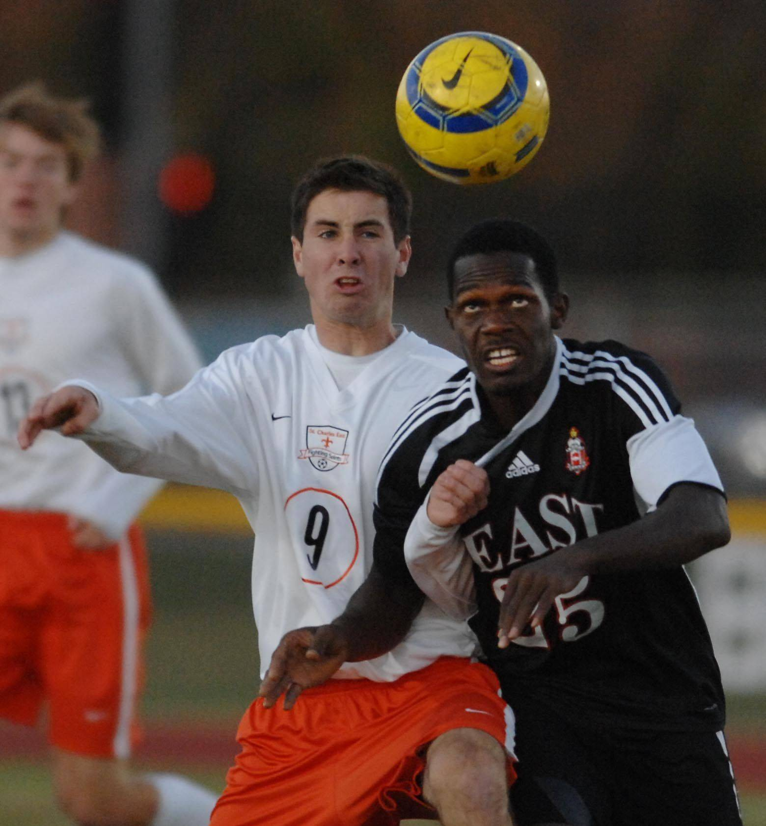St. Charles East's Brian Gielow battles with East Aurora's Abraham Kanneh Wednesday during the Upstate Eight boys soccer championship game at St. Charles East.