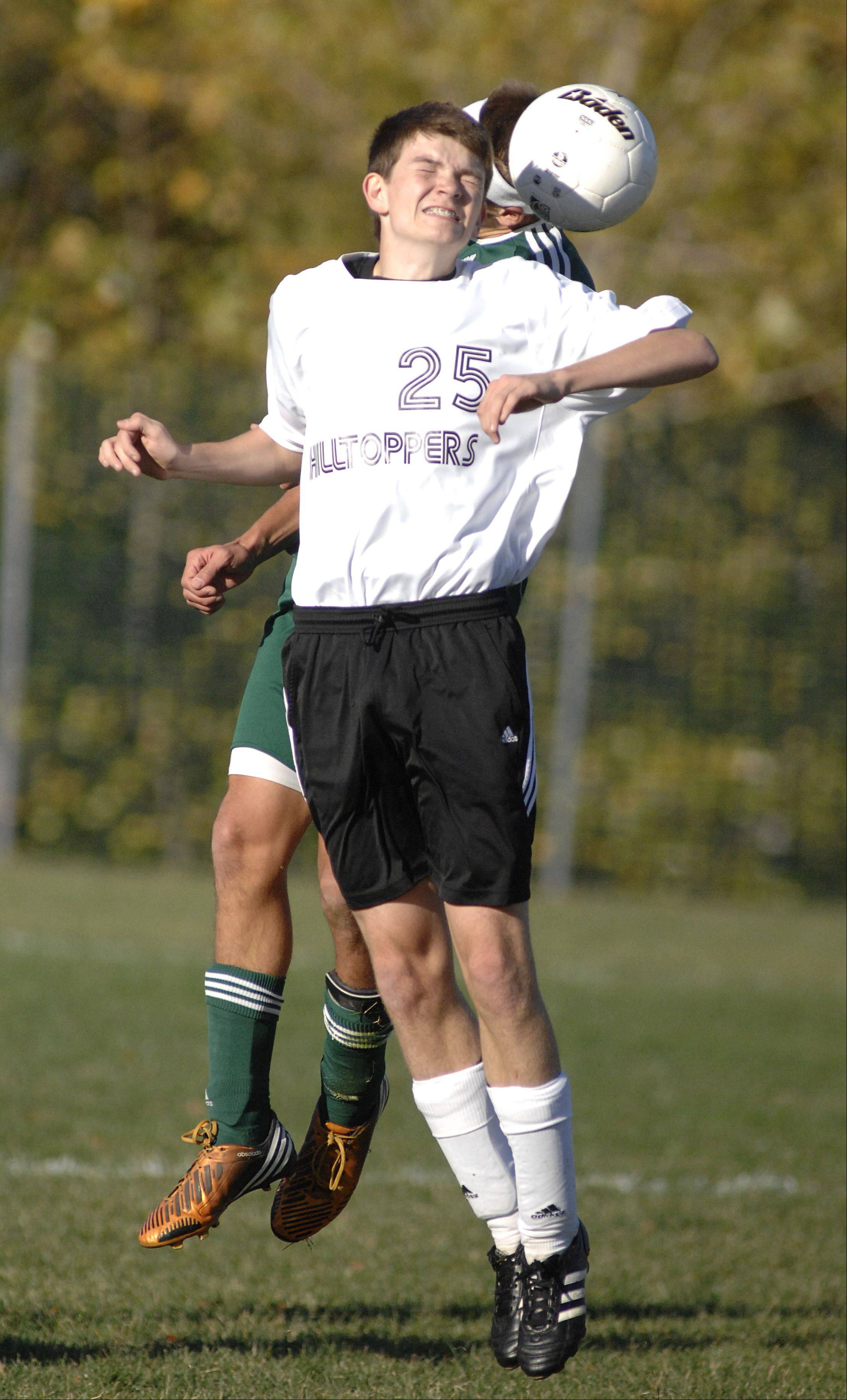 St. Edward's Johnny Shepherd collides with Elgin Academy's Billy Gracik in the first half on Wednesday, October 10.