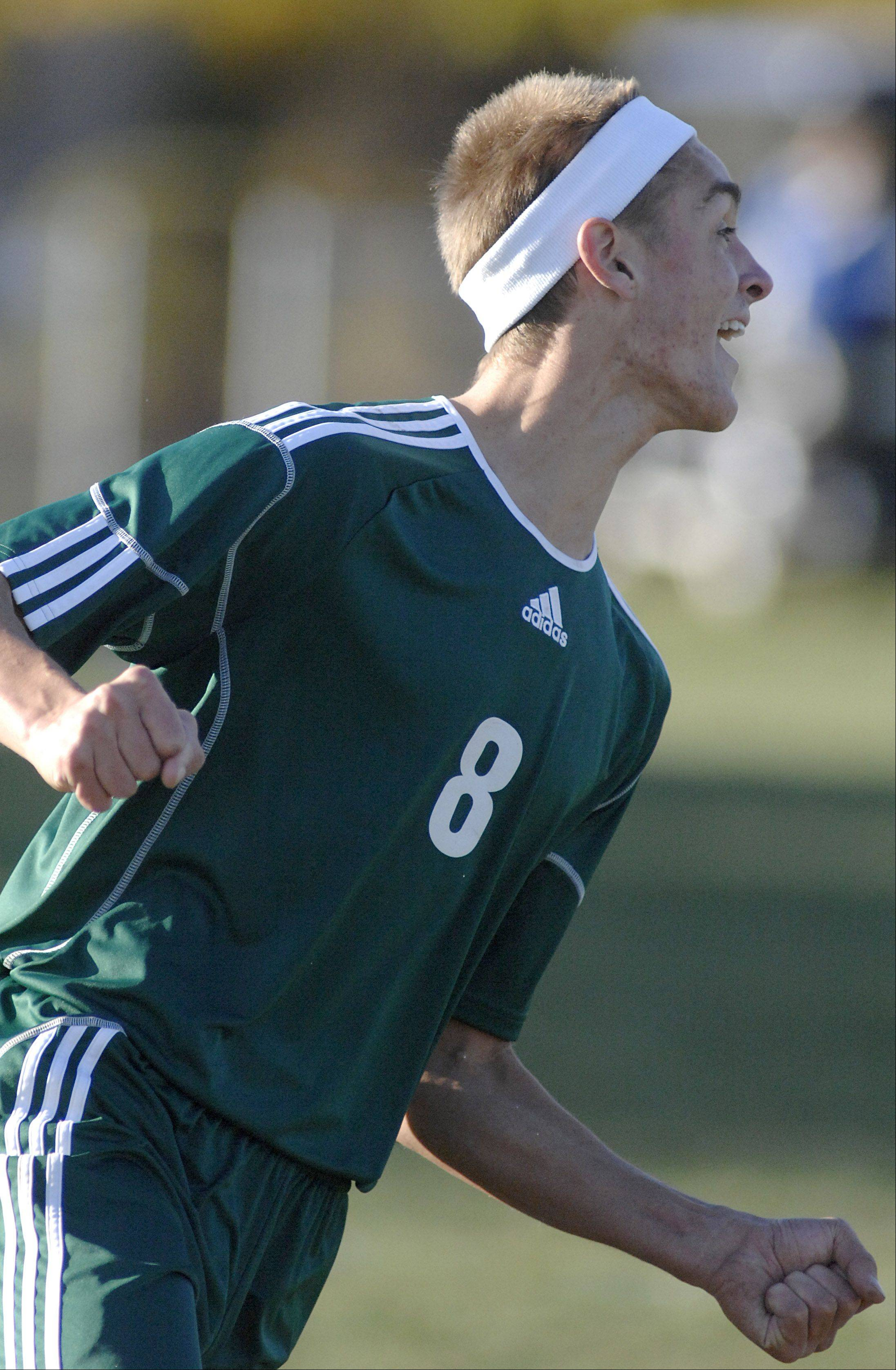 St. Edward's Johnny Shepherd celebrates his goal over Elgin Academy in the first half on Wednesday, October 10.