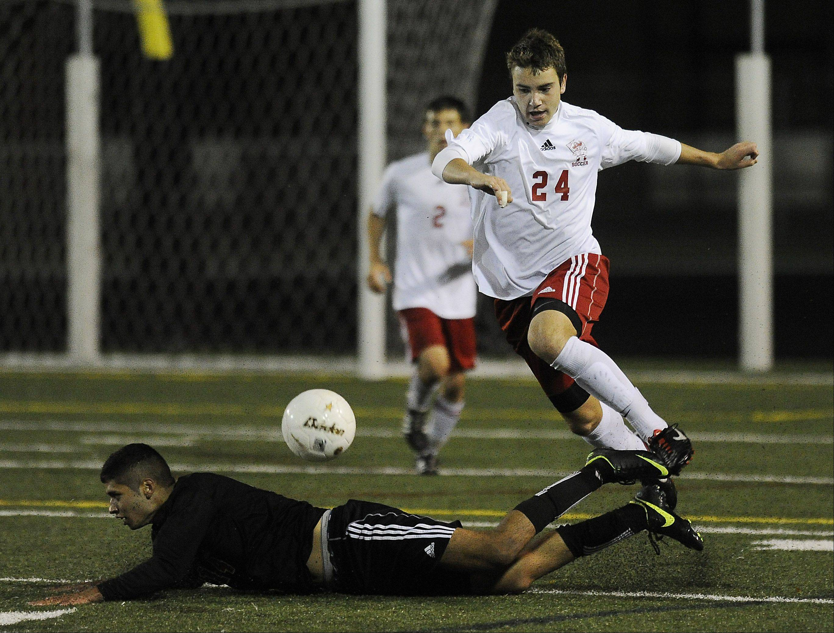 Palatine's Jeremy Velinski hurdles Barrington's Fernando Telles during the Pirates' 1-0 MSL West-clinching victory last Thursday.