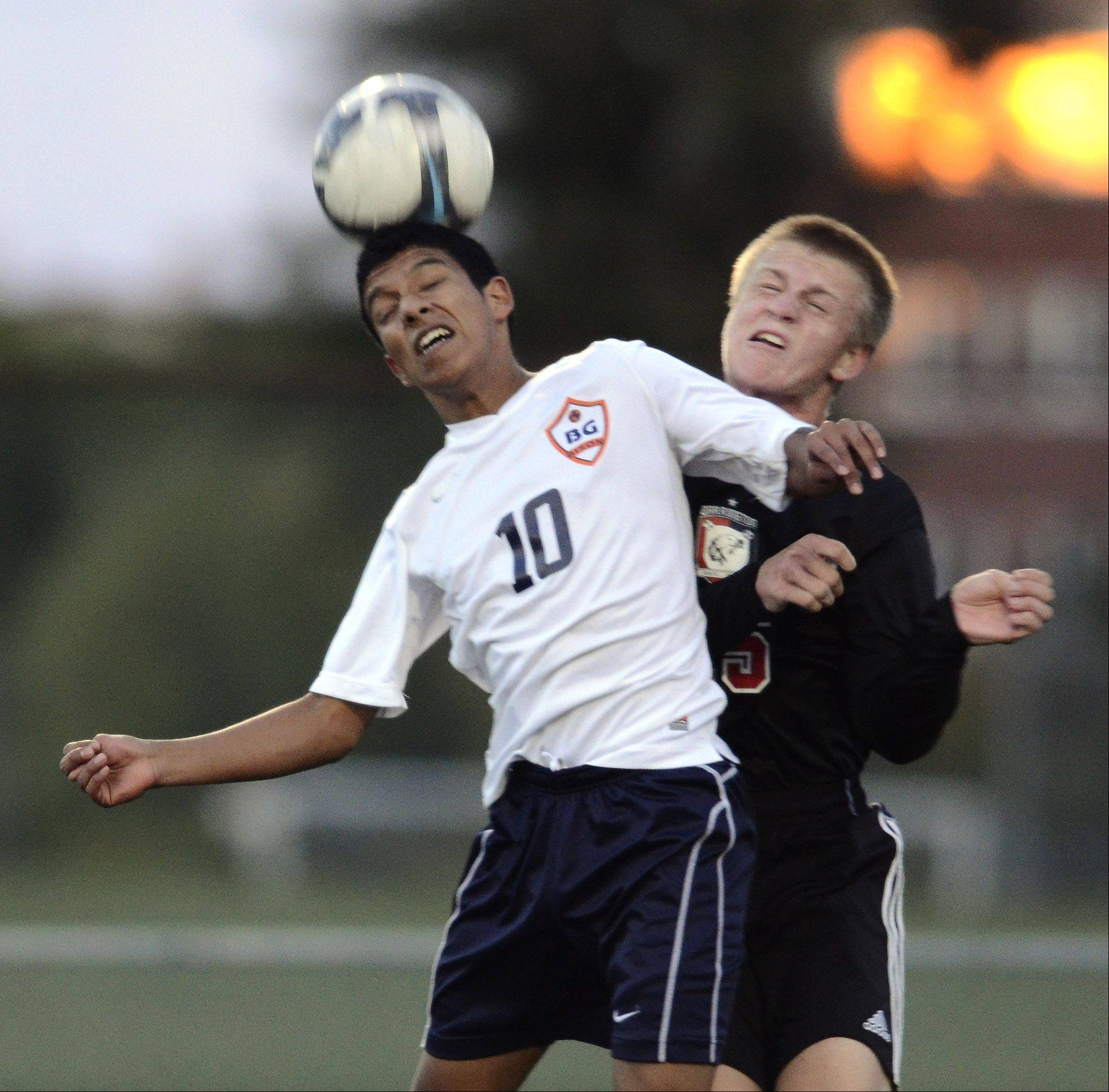 Buffalo Grove's Alberto Eloyza, left, leaps for a header in front of Barrington's Dylan Nelson.