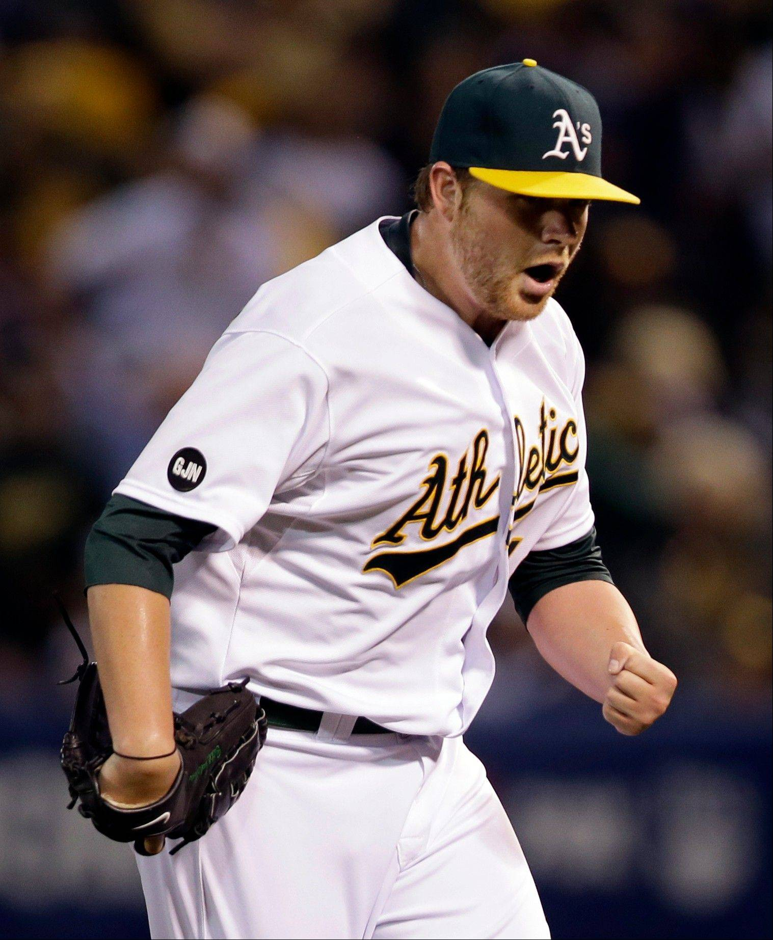 Oakland Athletics starting pitcher Brett Anderson pumps his fist after Detroit Tigers' Omar Infante hit into a double play to end the top of the third inning Tuesday during Game 3 of an American League division series in Oakland, Calif.