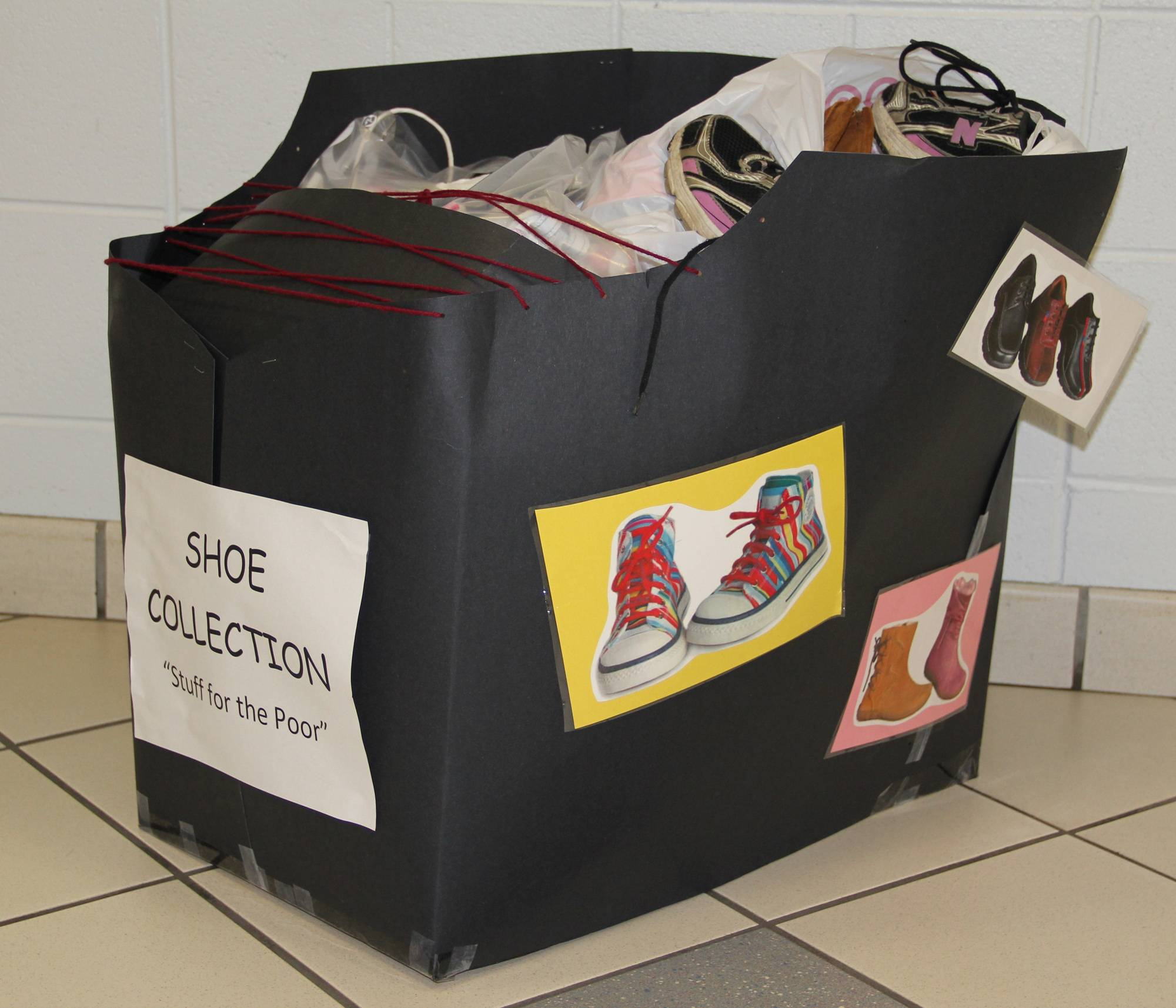 A shoe container from last year's used shoe collection sits filled with donations.
