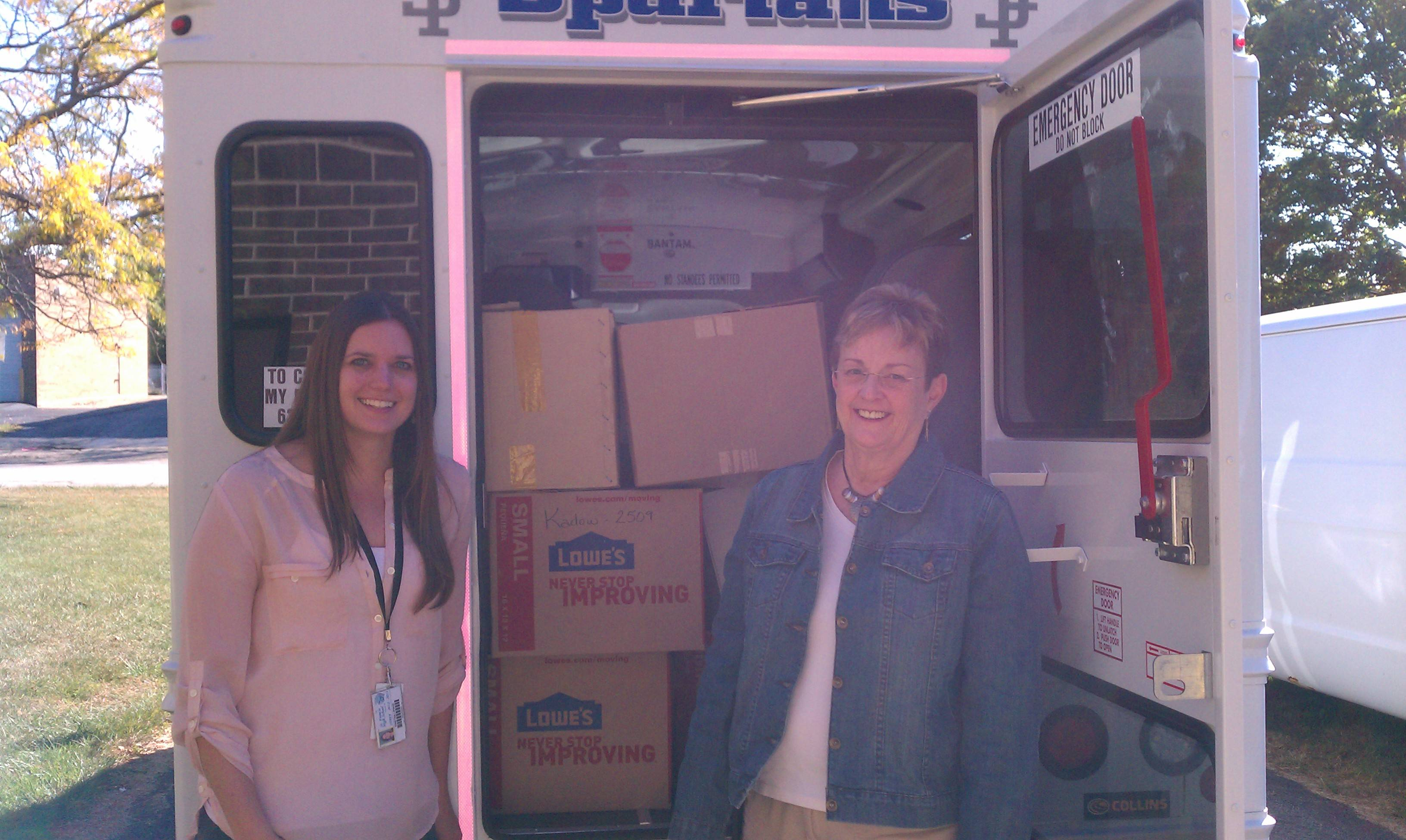 St. Francis High School math teachers Kristina Lipskis (left) and Joan Kustak (right) delivering the school supplies collected from the school's drive to HSP.