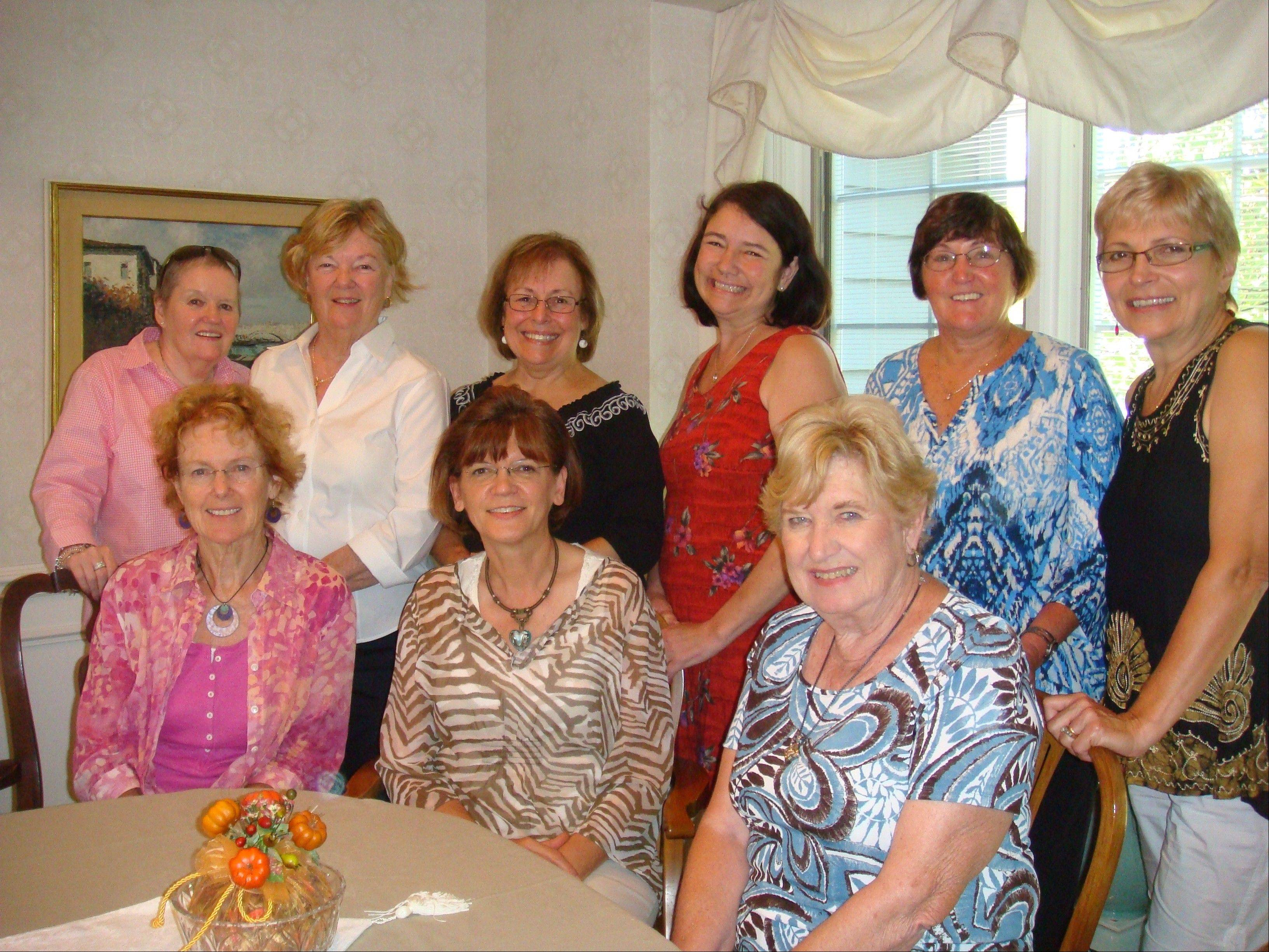 Members of the Four Seasons Garden Club at the October meeting, from left, are: Standing: Patricia Toole, Lenore Lawrence, Donnaruth Schaul, Cheryl Trzupek, Carolyn Roussel and Alena Gust; seated: Judy Palmer, Gail Bachmann and Nancy Marshall.