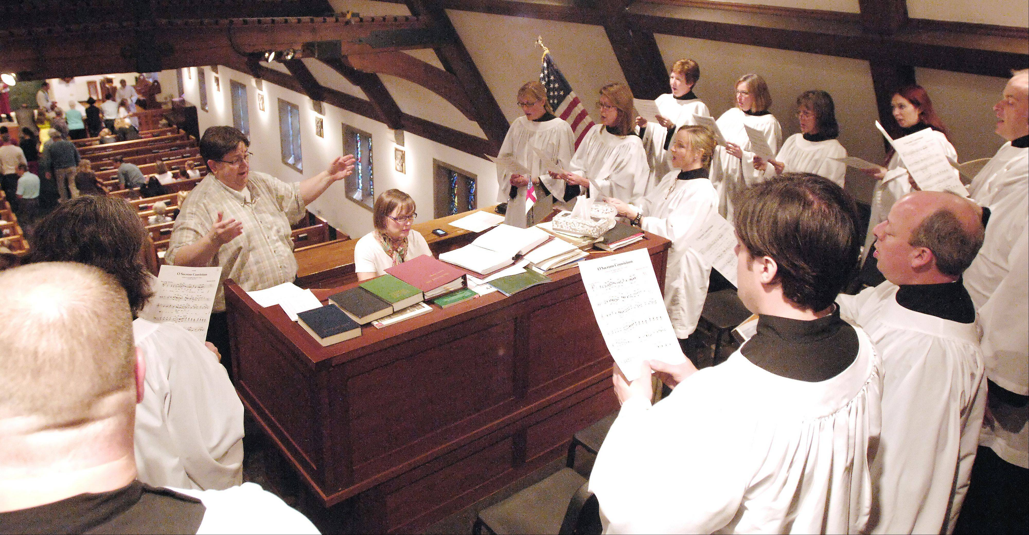 Organist and choirmaster Charles Snider leads the choir as he celebrates his 25th anniversary at St. Mark�s Episcopal Church in Glen Ellyn.