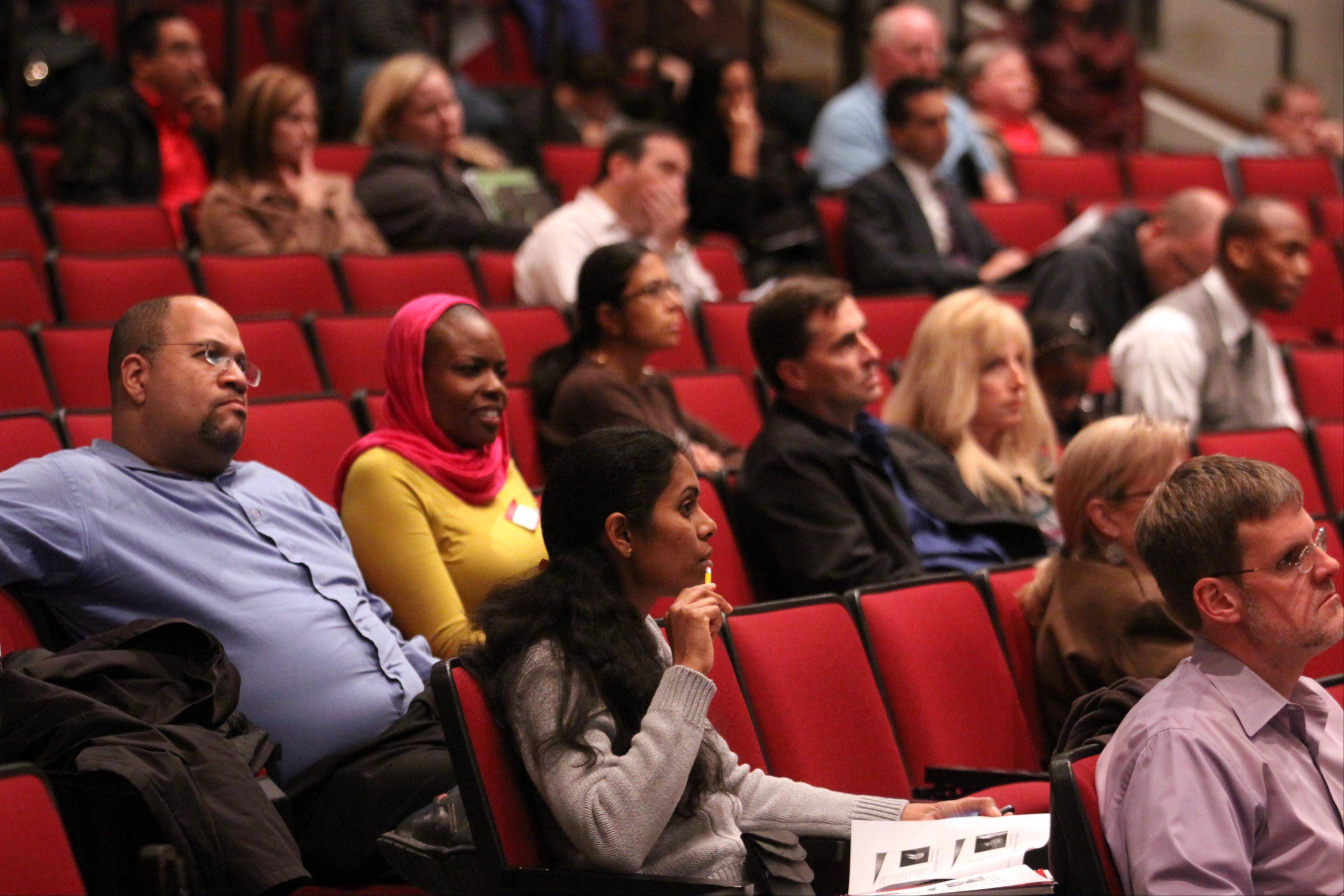 Audience members listen during a general election forum at Elgin High School on Thursday night.