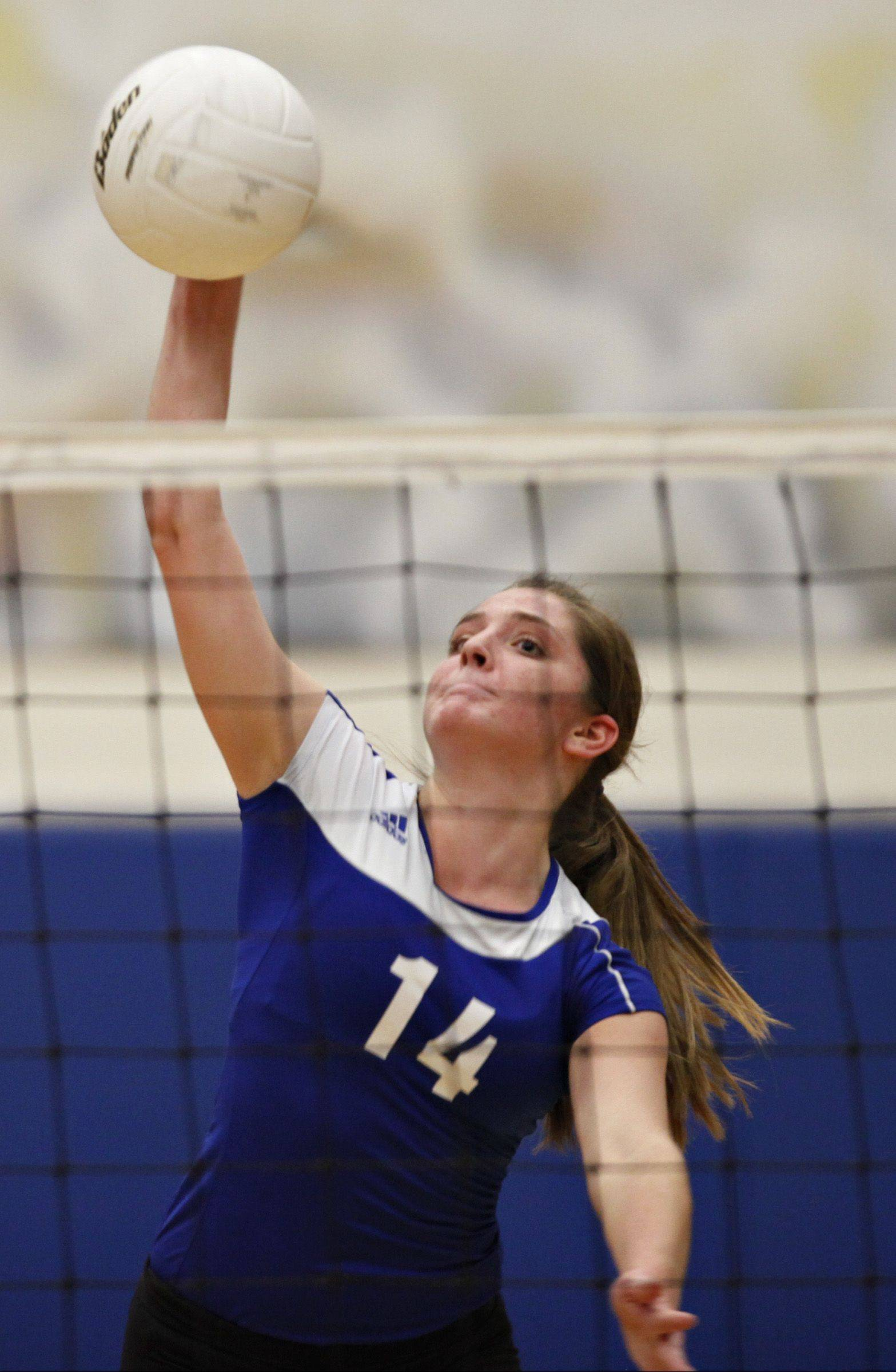 Central�s Lauren Wiltsie goes for a kill against Richmond-Burton Thursday night.