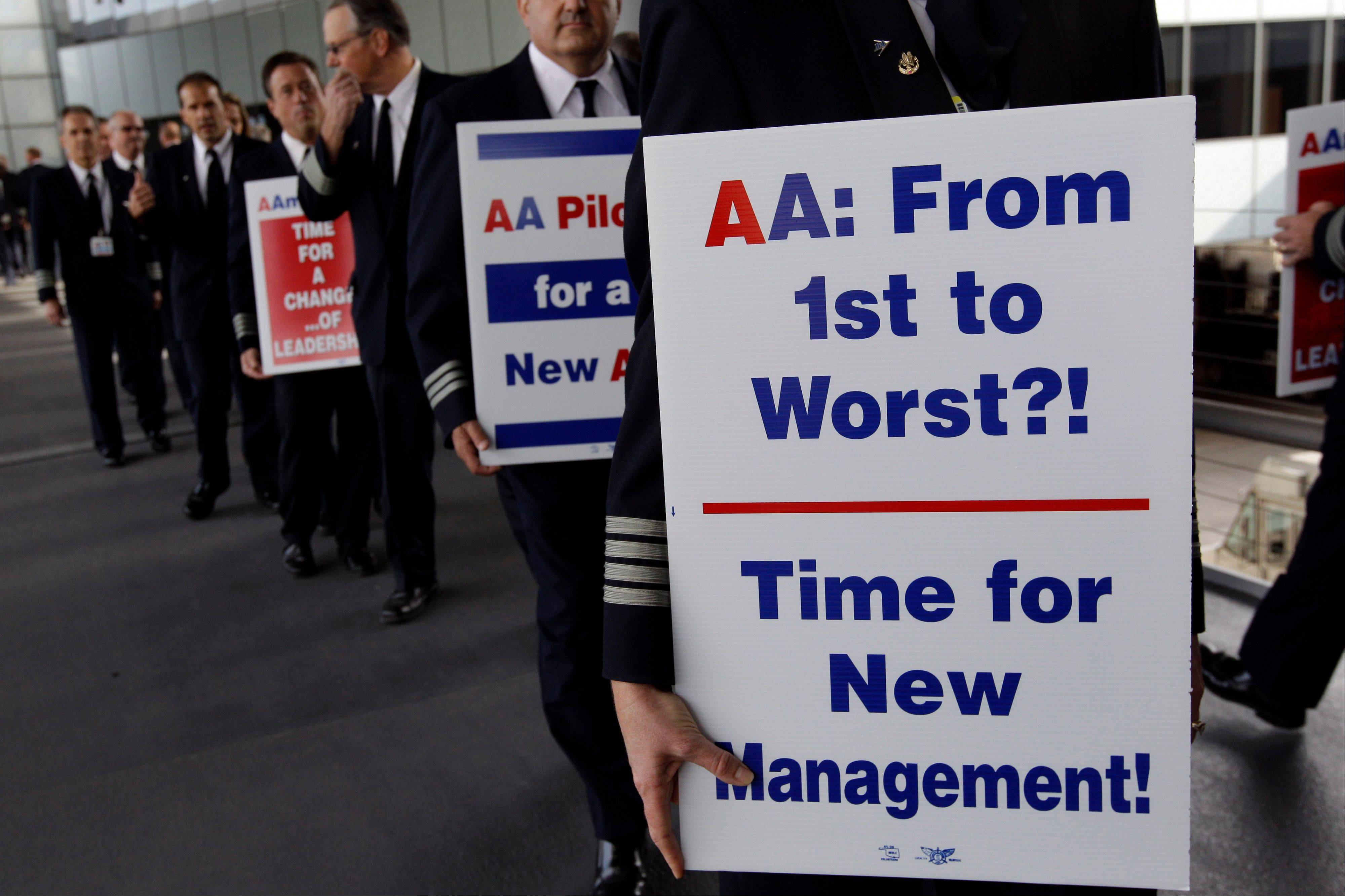 In this file photo from Sept. 20, over 200 American Airline pilots march on a picket line at O'Hare International.