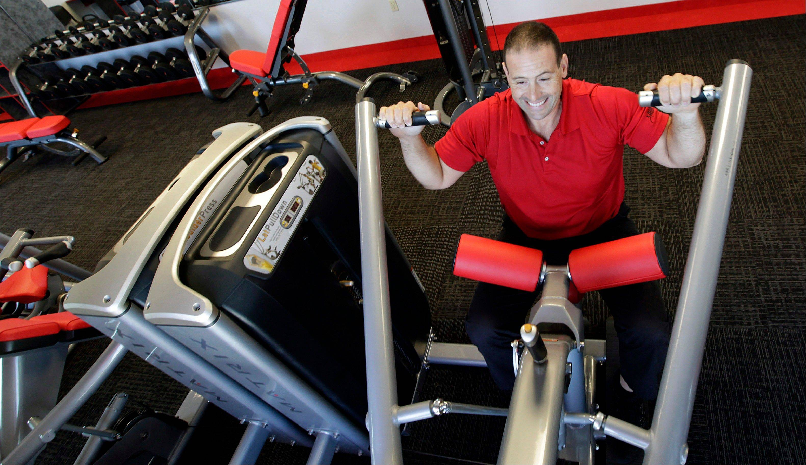 Gym manager Rick Limitone demonstrates a workout machine at Snap Fitness Rolling Strong Gym. a truck stop gym in Dallas. From trucking companies embracing wellness and weight-loss programs to gyms being installed at truck stops, momentum has picked up in recent years to help those who make their living driving big rigs get into shape.