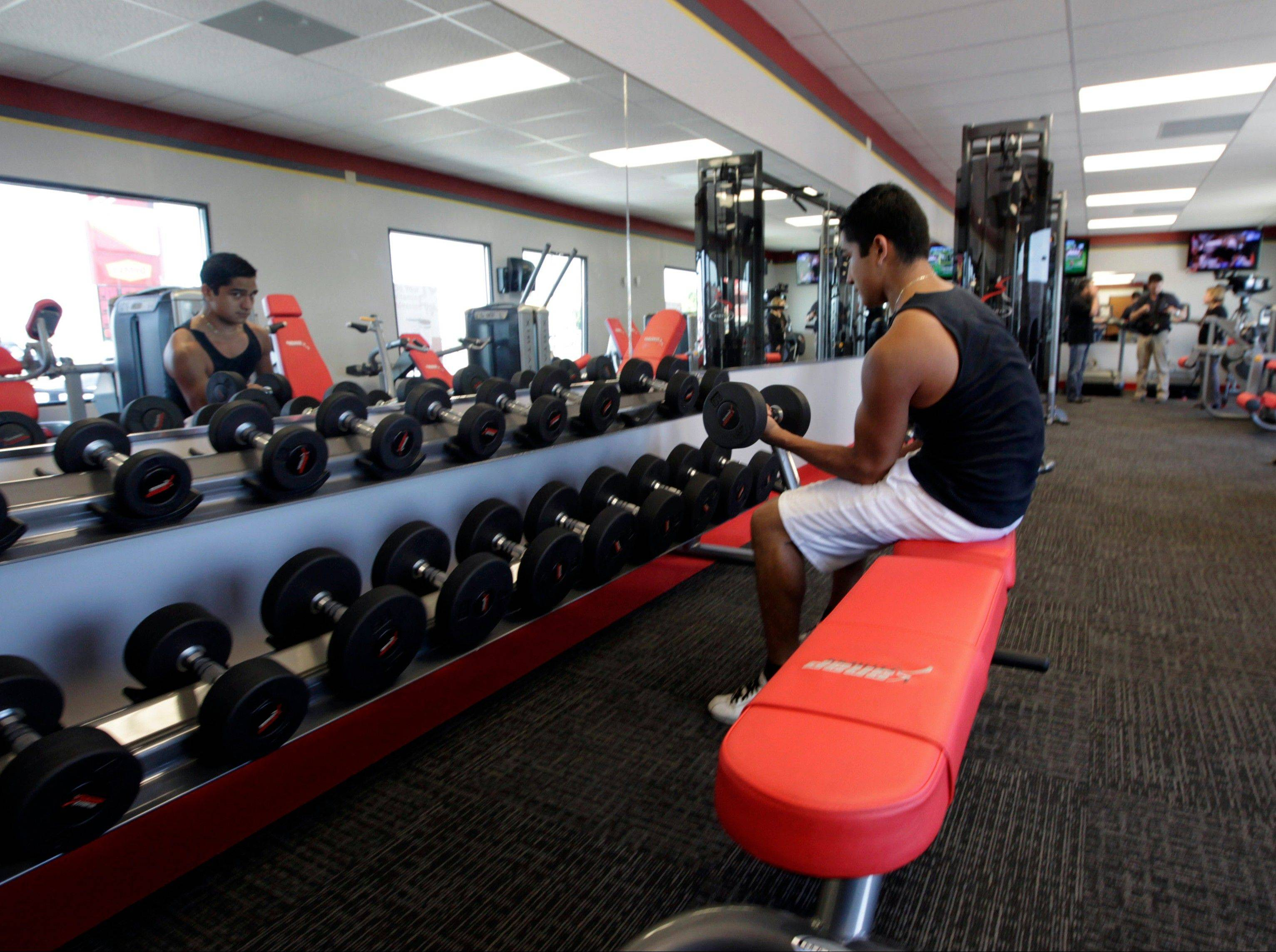 A customer works out at Snap Fitness Rolling Strong Gym at a truck stop in Dallas. From trucking companies embracing wellness and weight-loss programs to gyms being installed at truck stops, momentum has picked up in recent years to help those who make their living driving big rigs get into shape.