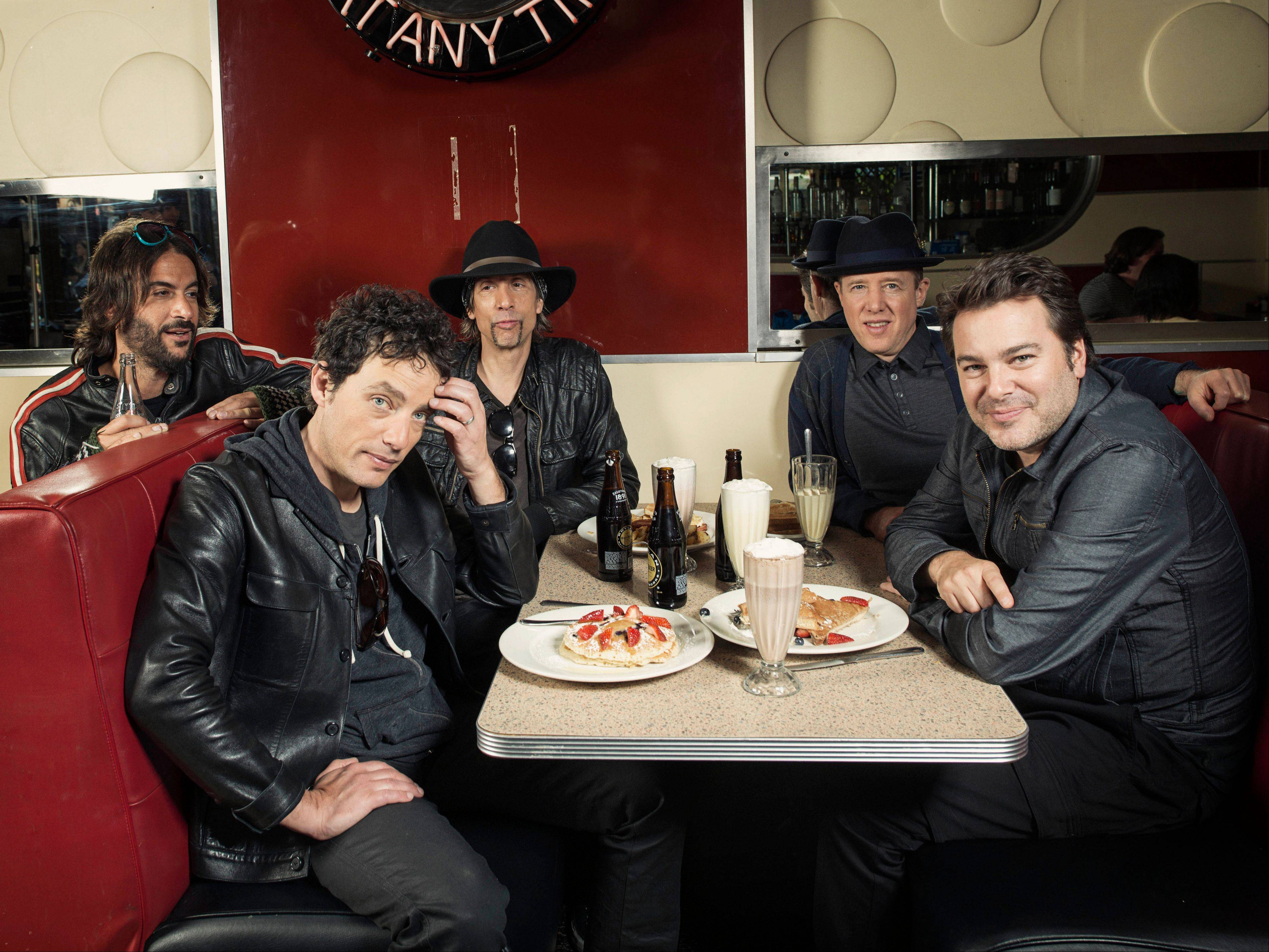 "The Wallflowers, from left, Rami Jaffee, Jakob Dylan, Stuart Mathis, Jack Irons and Greg Richling, released ""Glad All Over,"" their first new album in seven years, this month."