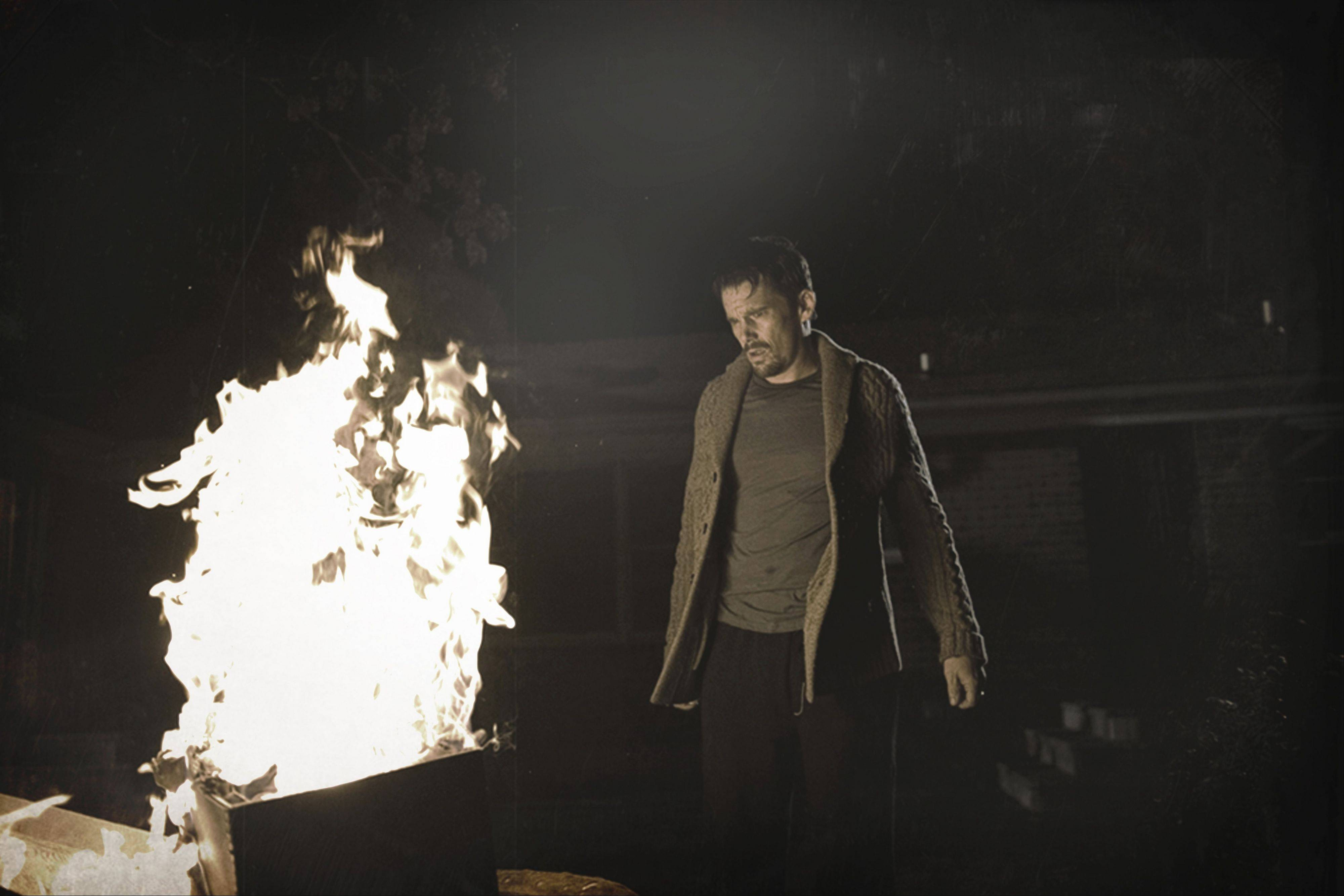 "Writer Ellison Oswald (Ethan Hawke) tries to burn away his troubles by destroying old Super-8 movies in the horror film ""Sinister."""