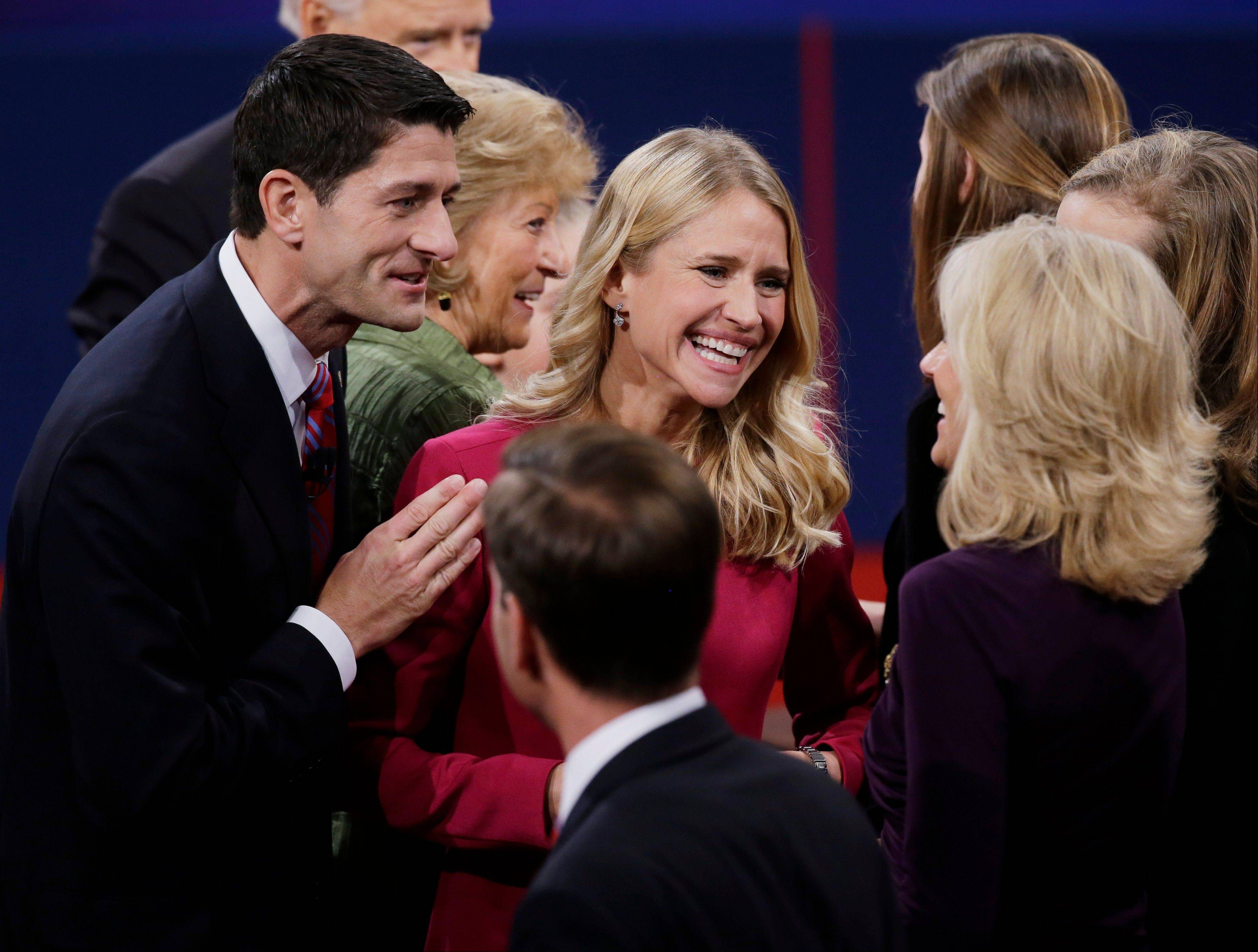 Republican vice presidential nominee Rep. Paul Ryan of Wisconsin and wife Janna Ryan talk to Jill Biden, wife of Vice President Joe Biden, after the vice presidential debate Thursday.