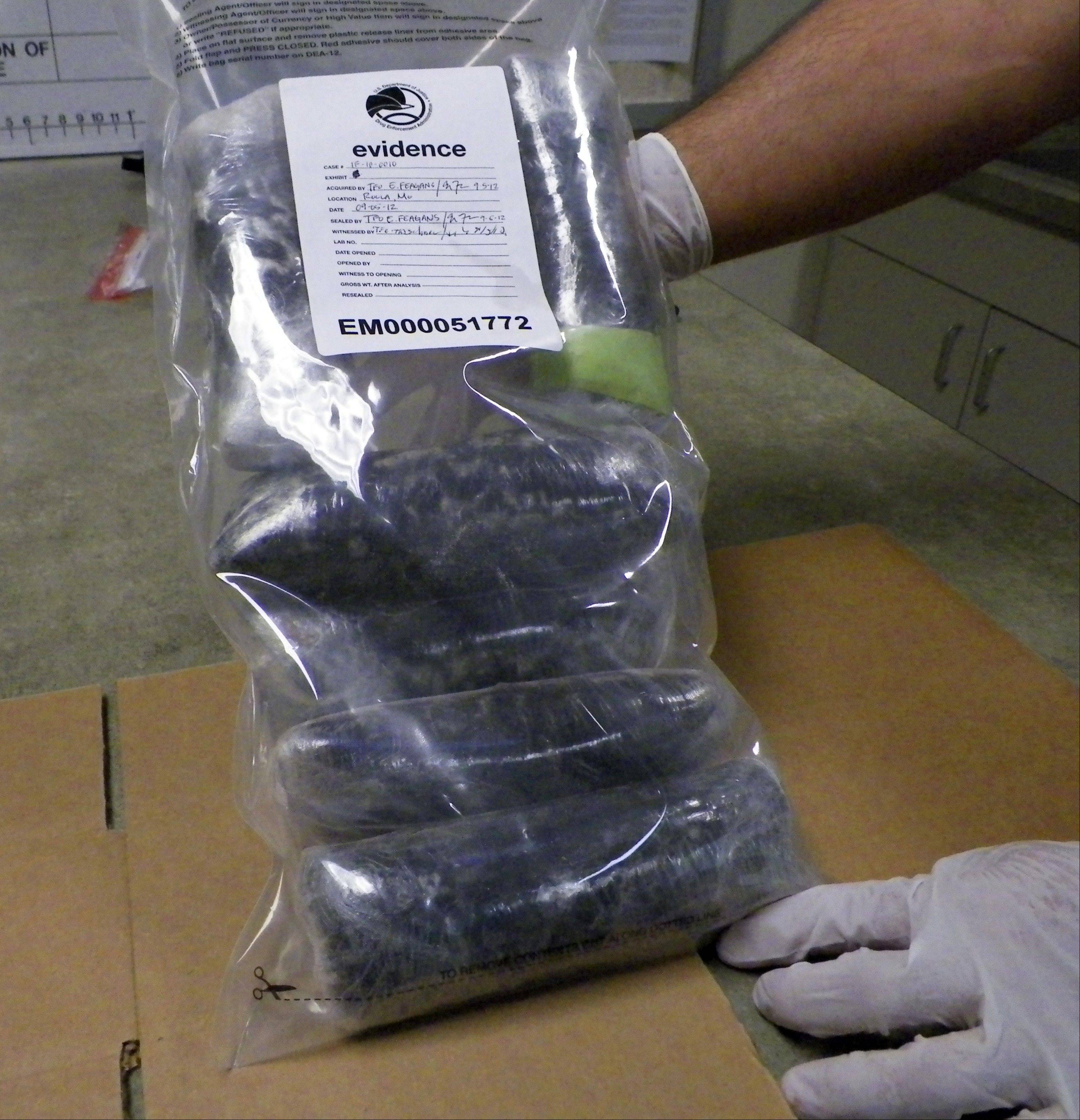 A U.S. Drug Enforcement Administration technician holds several pounds of Mexican meth confiscated in the St. Louis area.