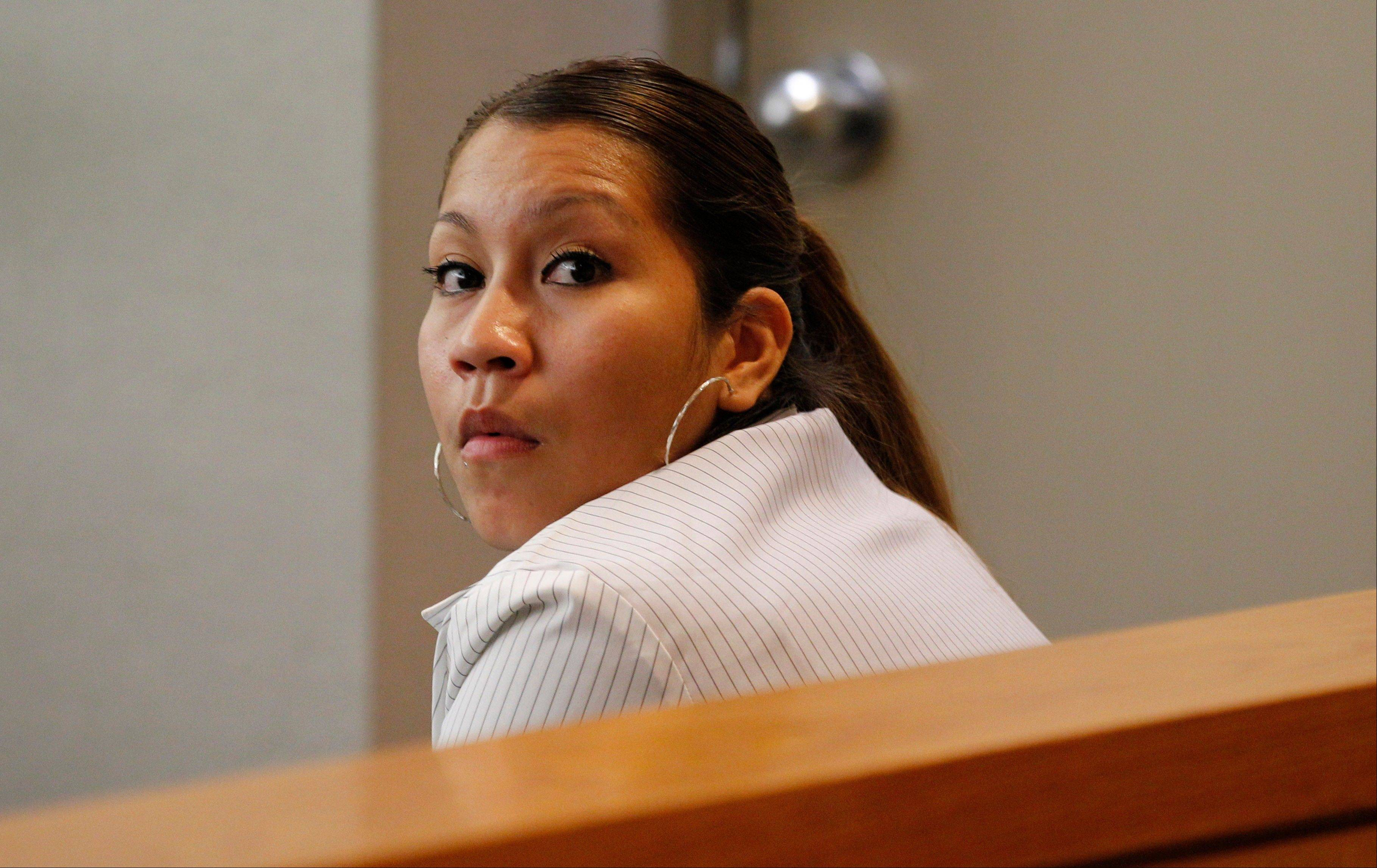 Elizabeth Escalona, 23, sits in a courtroom to be sentenced, in Dallas, Monday. She pleaded guilty July 12 to injury to a child and is facing up to life in prison.
