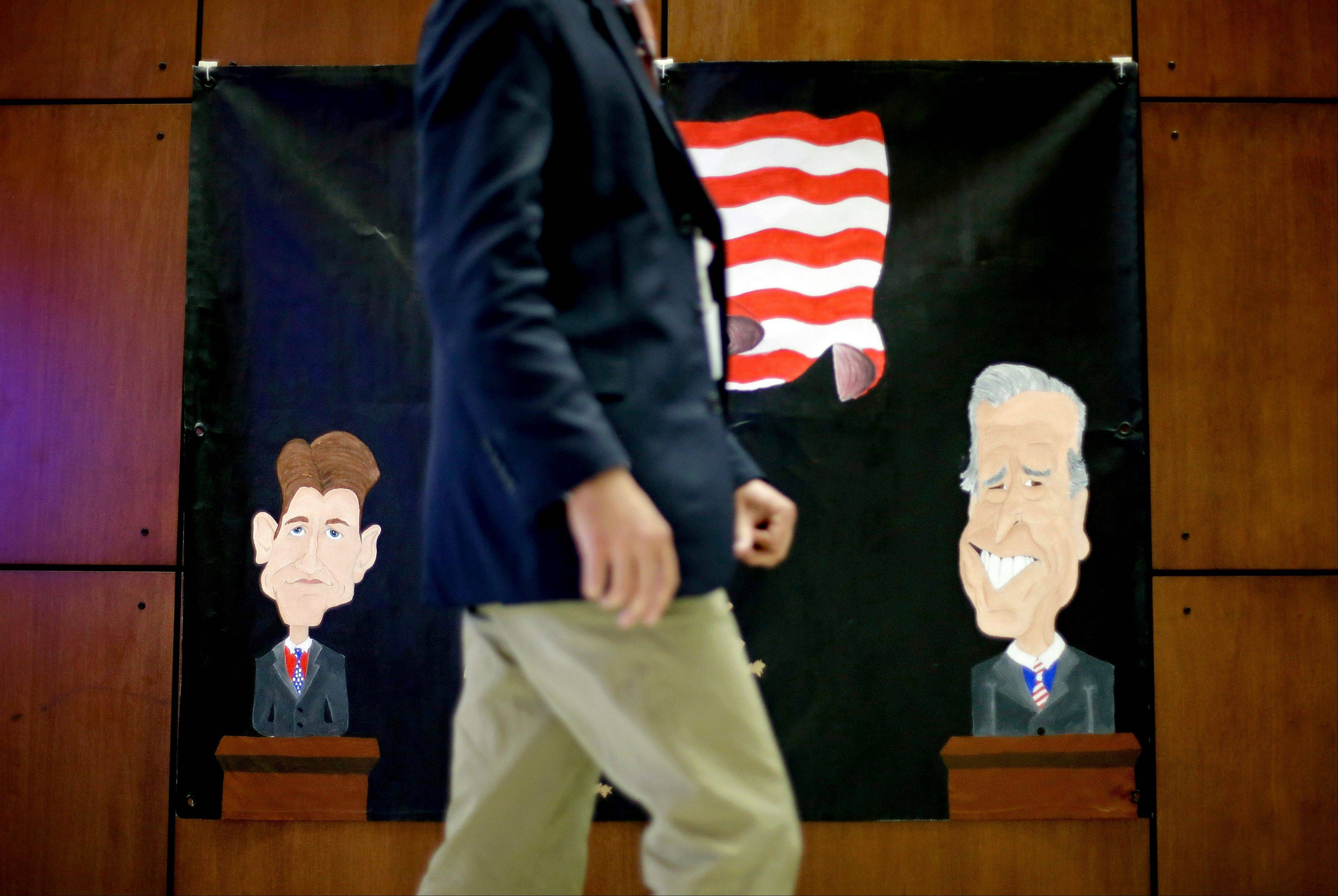 A banner made by a local middle school depicting Republican vice presidential candidate, Rep. Paul Ryan, R-Wis., at left, and Vice President Joe Biden, at right, hangs on the wall inside the media center ahead of Thursday's vice presidential debate at Centre College in Danville, Ky.