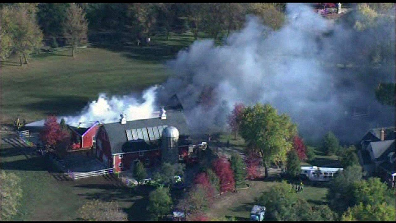 A Barrington Hills barn burns on Ridge Road.