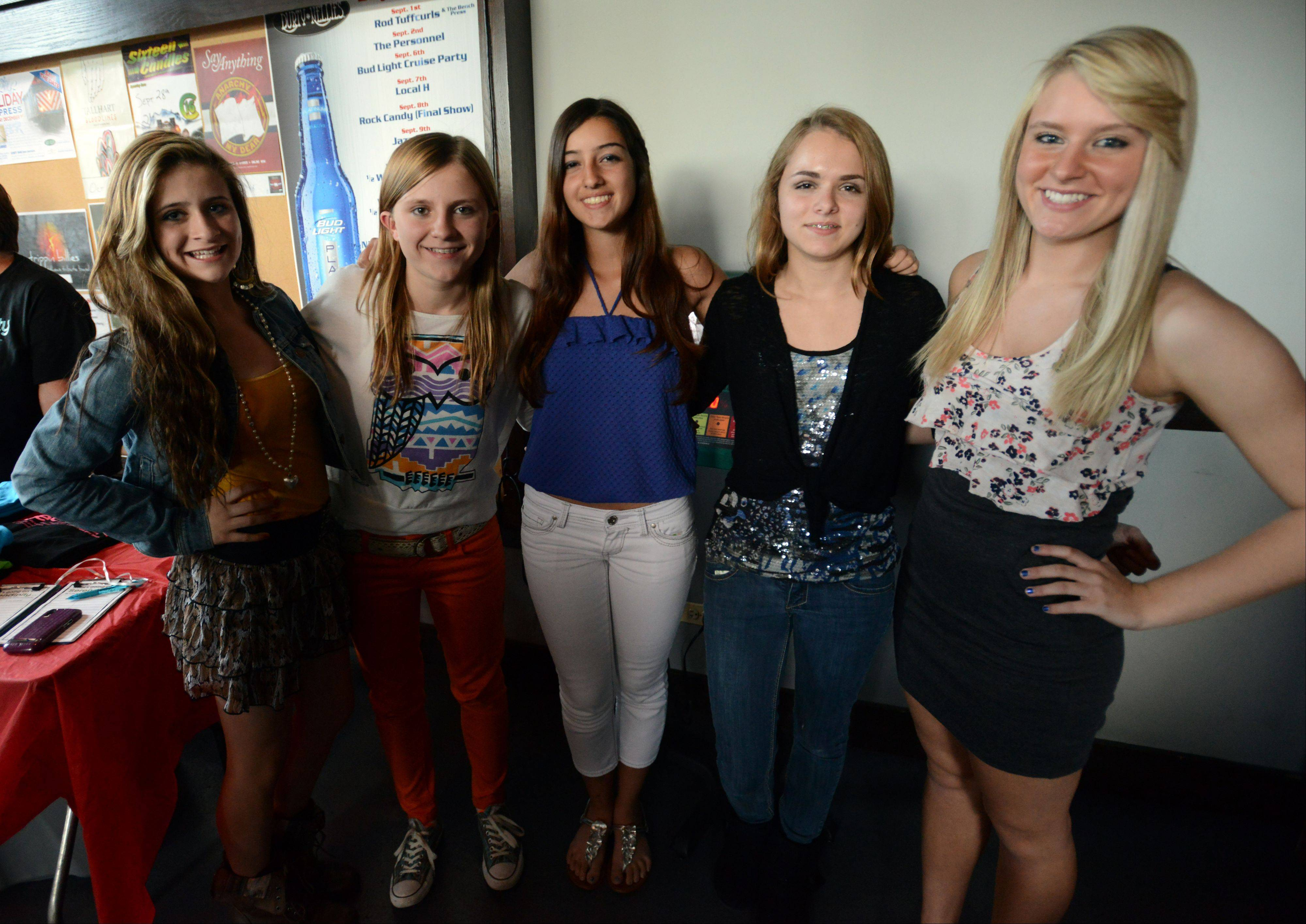 Serendipity band members Josie Treffy, 15, of South Elgin, Haley Blomquist, 15, of Elk Grove Village, Daniella Ballarino, 16, of Mount Prospect, and Anneliese Schulz, 15, of Elk Grove Village, with Lizzy Petitt, 15, of Arlington Heights, get ready to hit the stage.