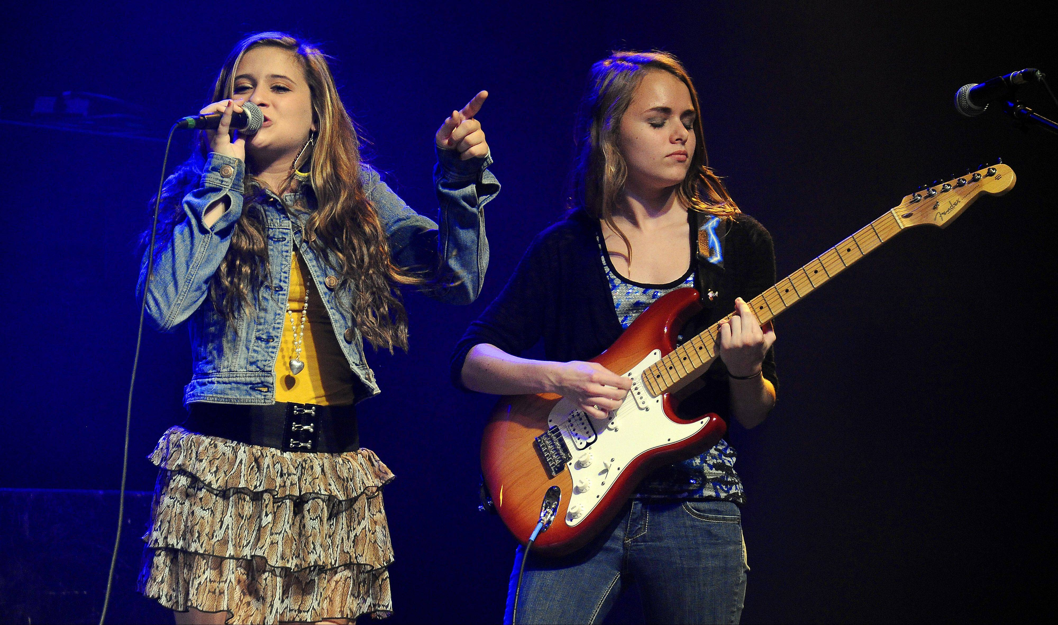 Serendipity band members Josie Treffy, 15, of South Elgin, and Anneliese Schulz, 15, of Elk Grove Village, rock the house at Durty Nellie's in Palatine.