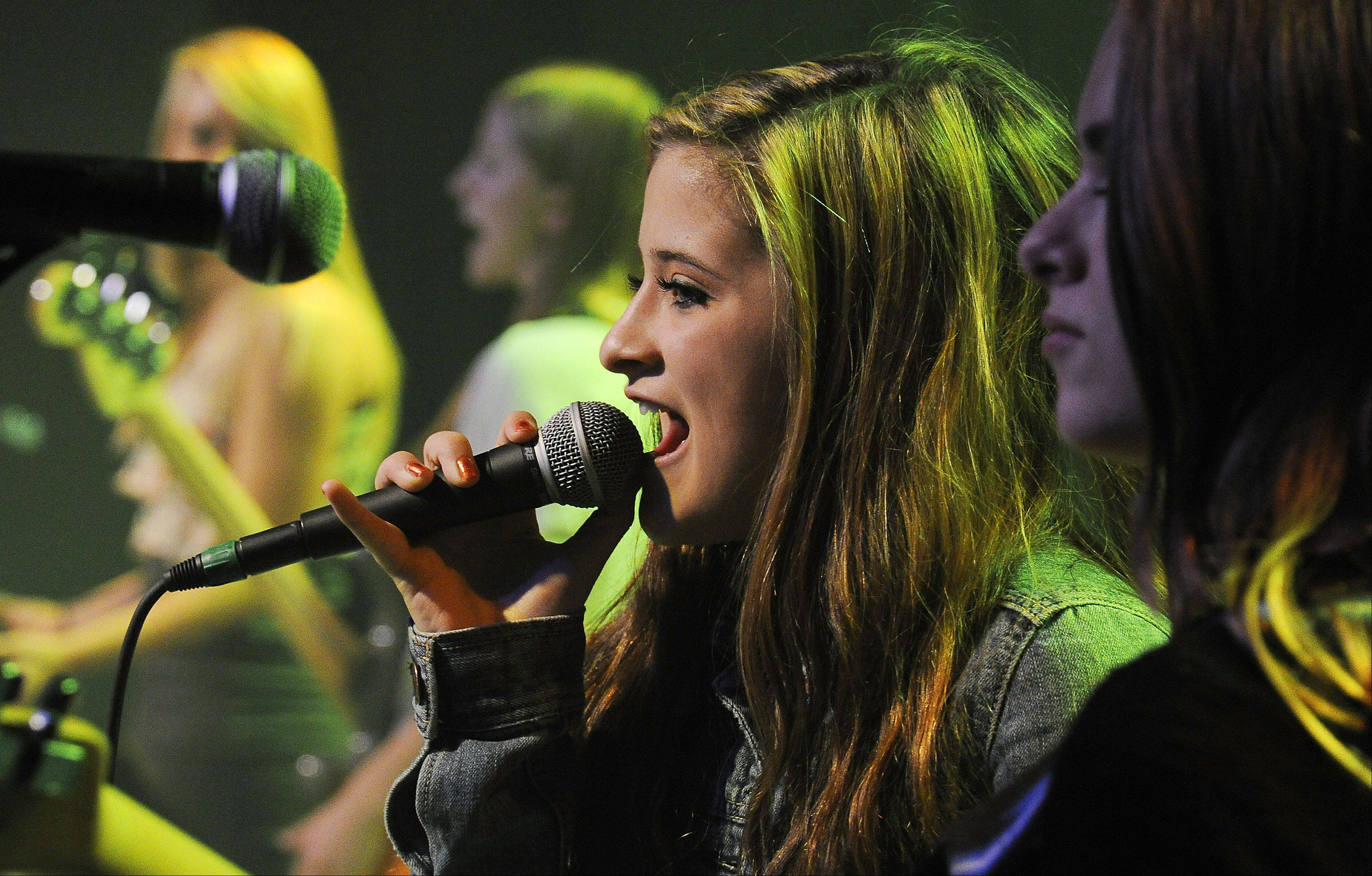 Serendipity lead singer Josie Treffy, 15, of South Elgin, sings for her fans at Durty Nellie's in Palatine.