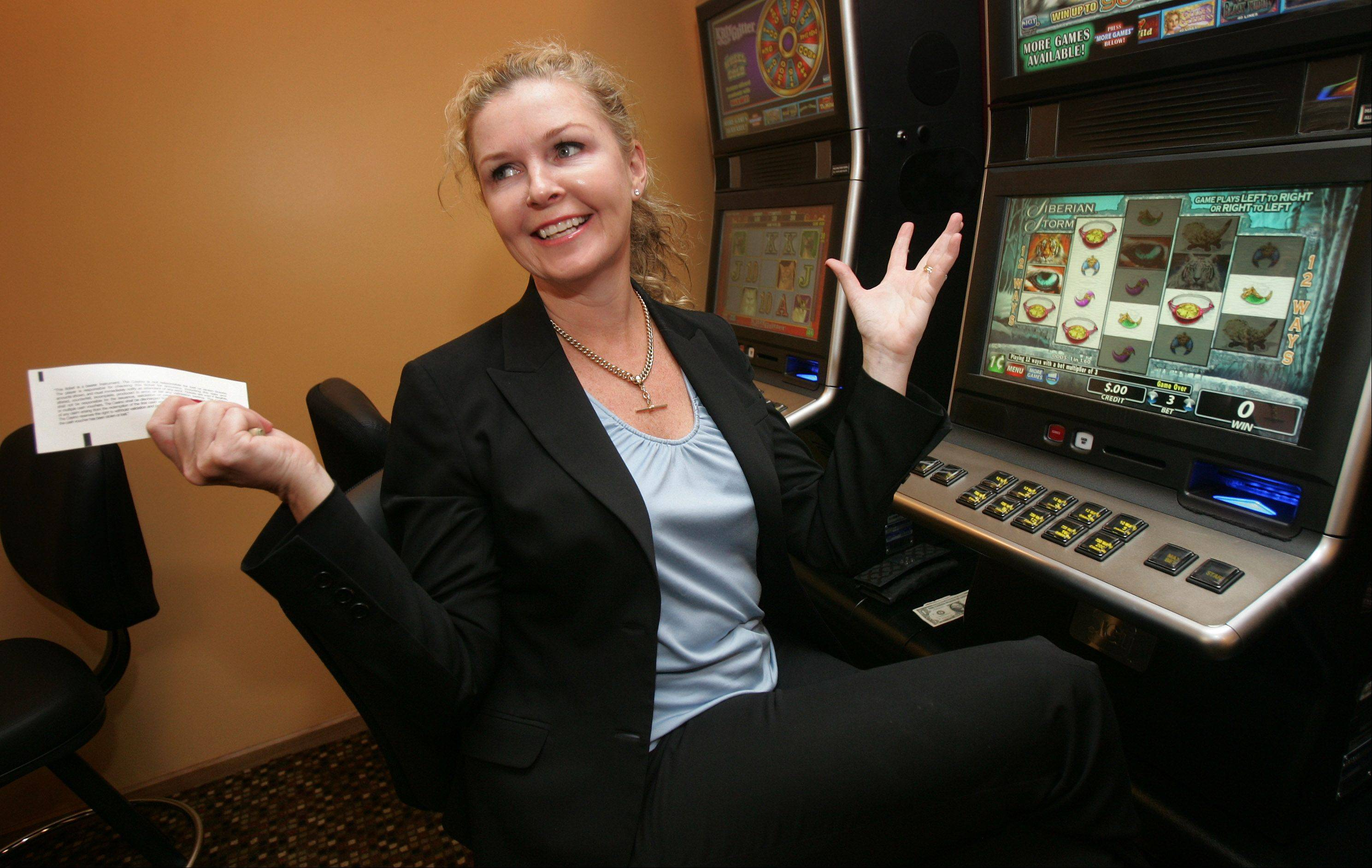 Demonstrating how video gambling works, Lynne Morris, CEO of Morris Gaming, celebrates a win.