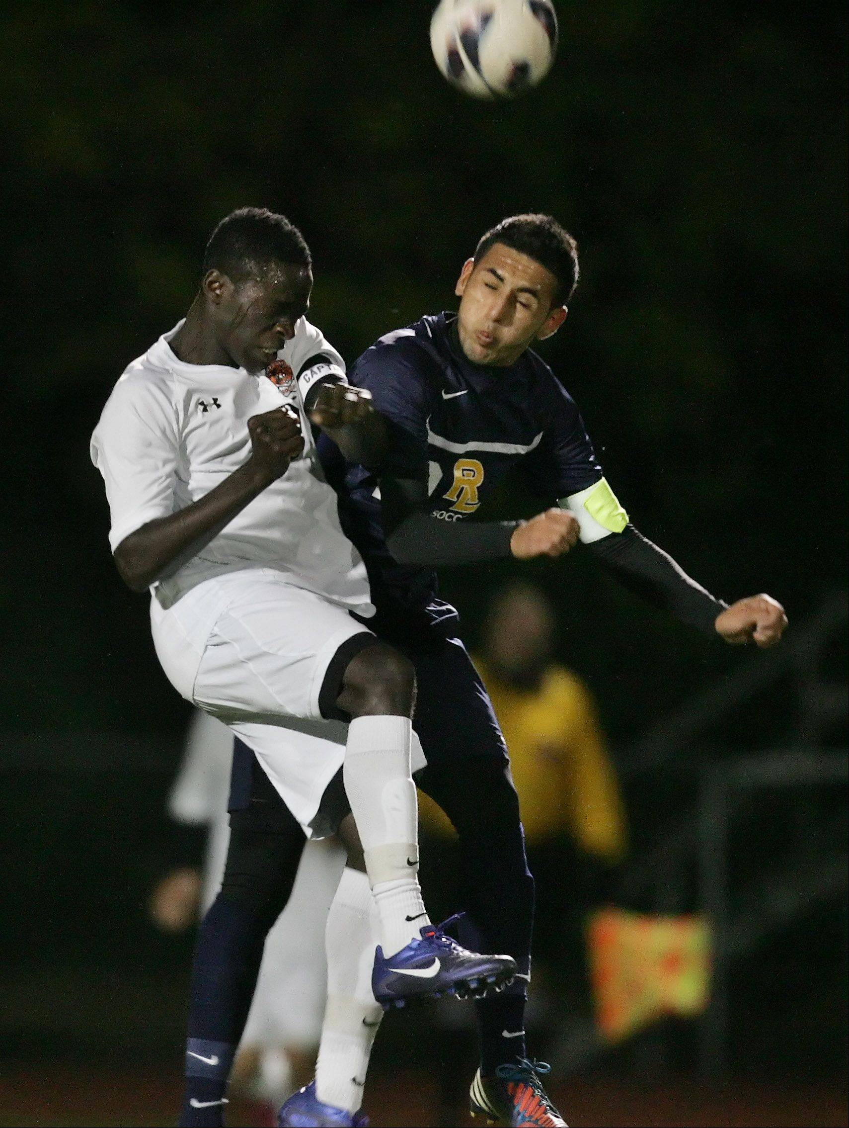 Libertyville's Tomide Owolabi and Round Lake's Lorenzo Cortez battle for a header in the first half of NSC championship play Thursday at Libertyville.