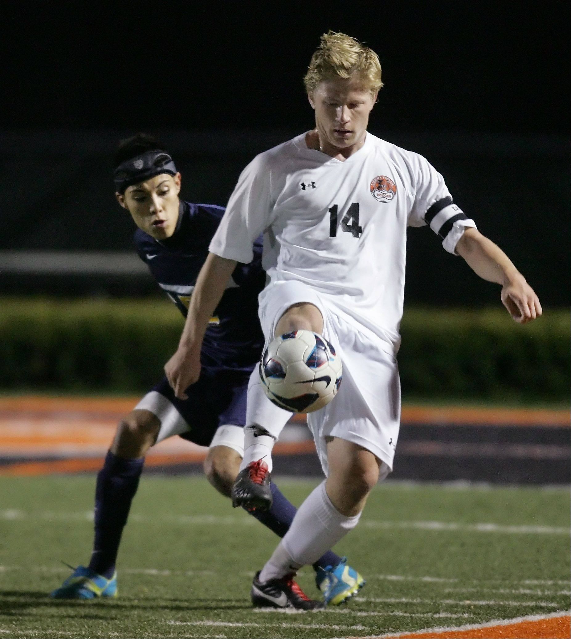 Libertyville forward Lloyd Chatfield III dribbles around Round Lake's Edgar Rodriguez in Thursday's North Suburban Conference title game at Libertyville.