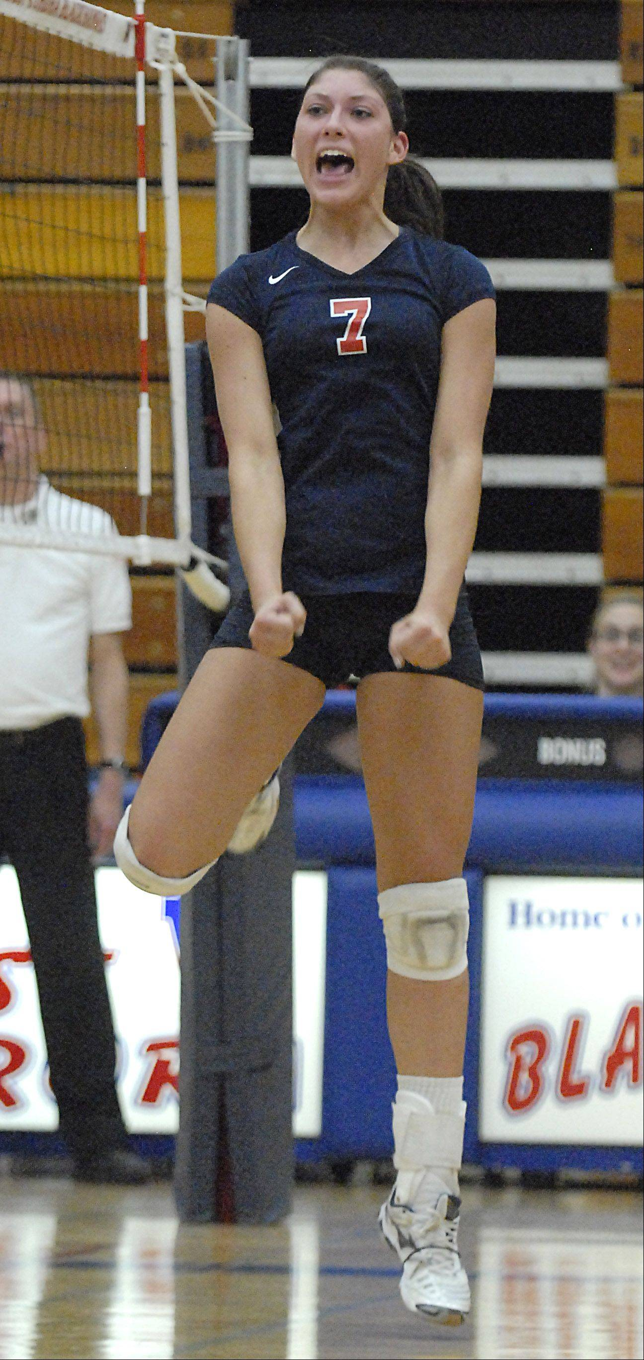 West Aurora's Lauren Carlini celebrates a point over Naperville North in the third game on Thursday, October 11.