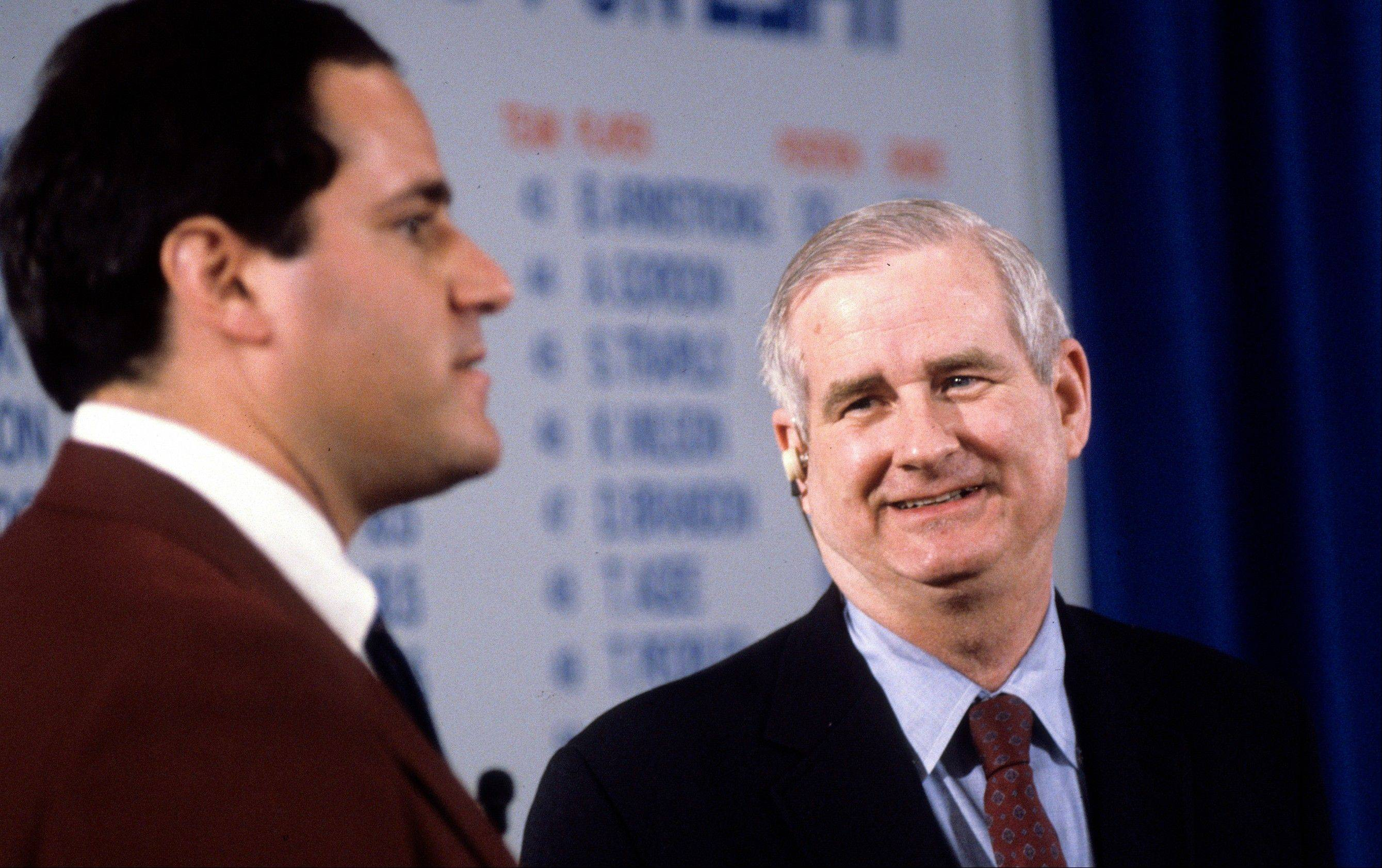 "ESPN host Chris Berman, left, and college football commentator Carroll ""Beano"" Cook are shown discussing the NFL Draft. Cook died in his sleep Thursday, the University of Pittsburgh announced. The 81 year-old commentator had worked for the sports network since 1986 and was the sports information director at his alma mater, the University of Pittsburgh, from 1956 to 1966."