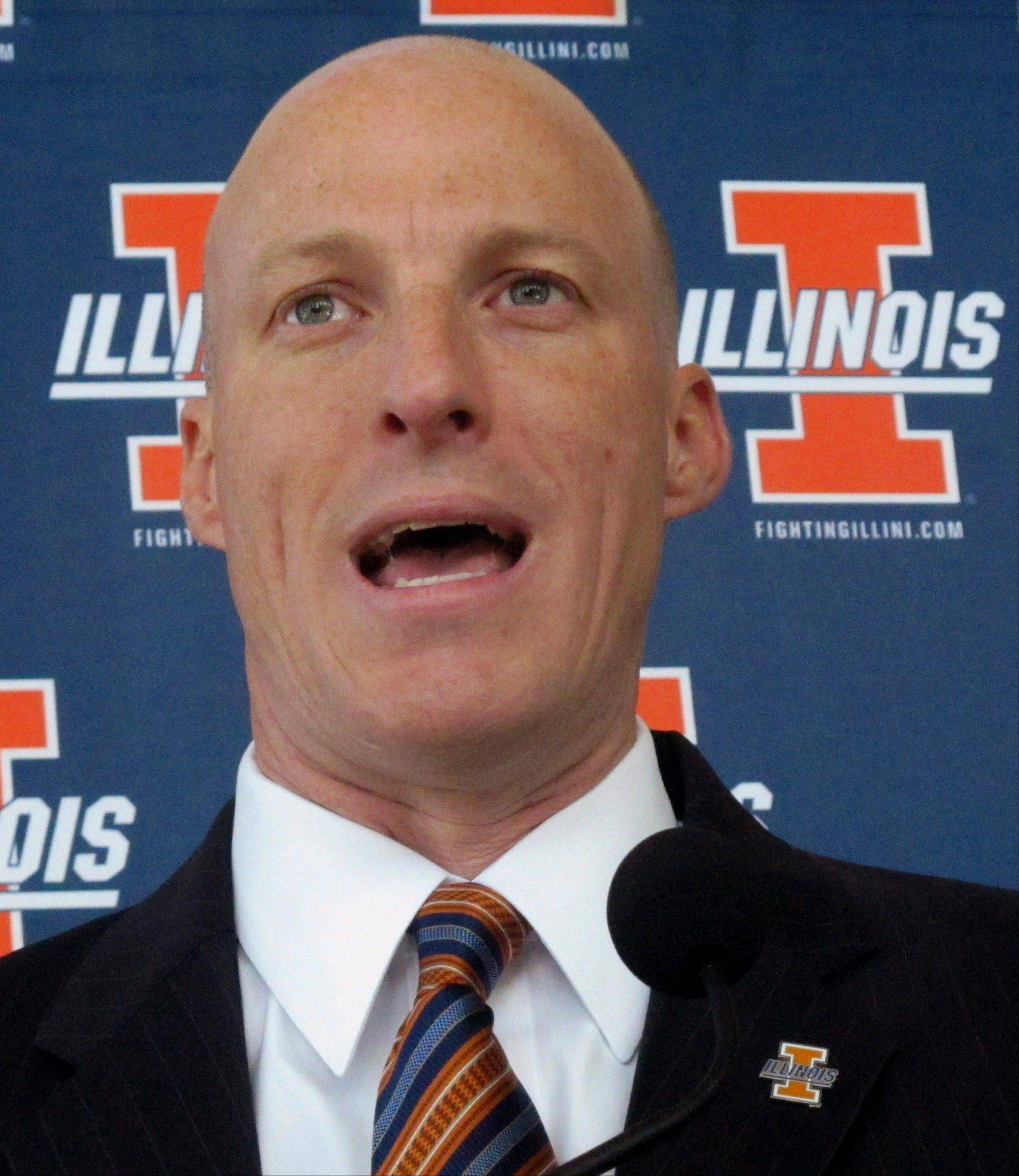 First-year Illinois basketball coach John Groce talks to reporters Wednesday during the team's media day in Champaign. Groce, who replaced Bruce Weber earlier this year, says he plans to play a fast-paced style but isn�t yet sure how much of that up-tempo game the team�s current roster can handle.