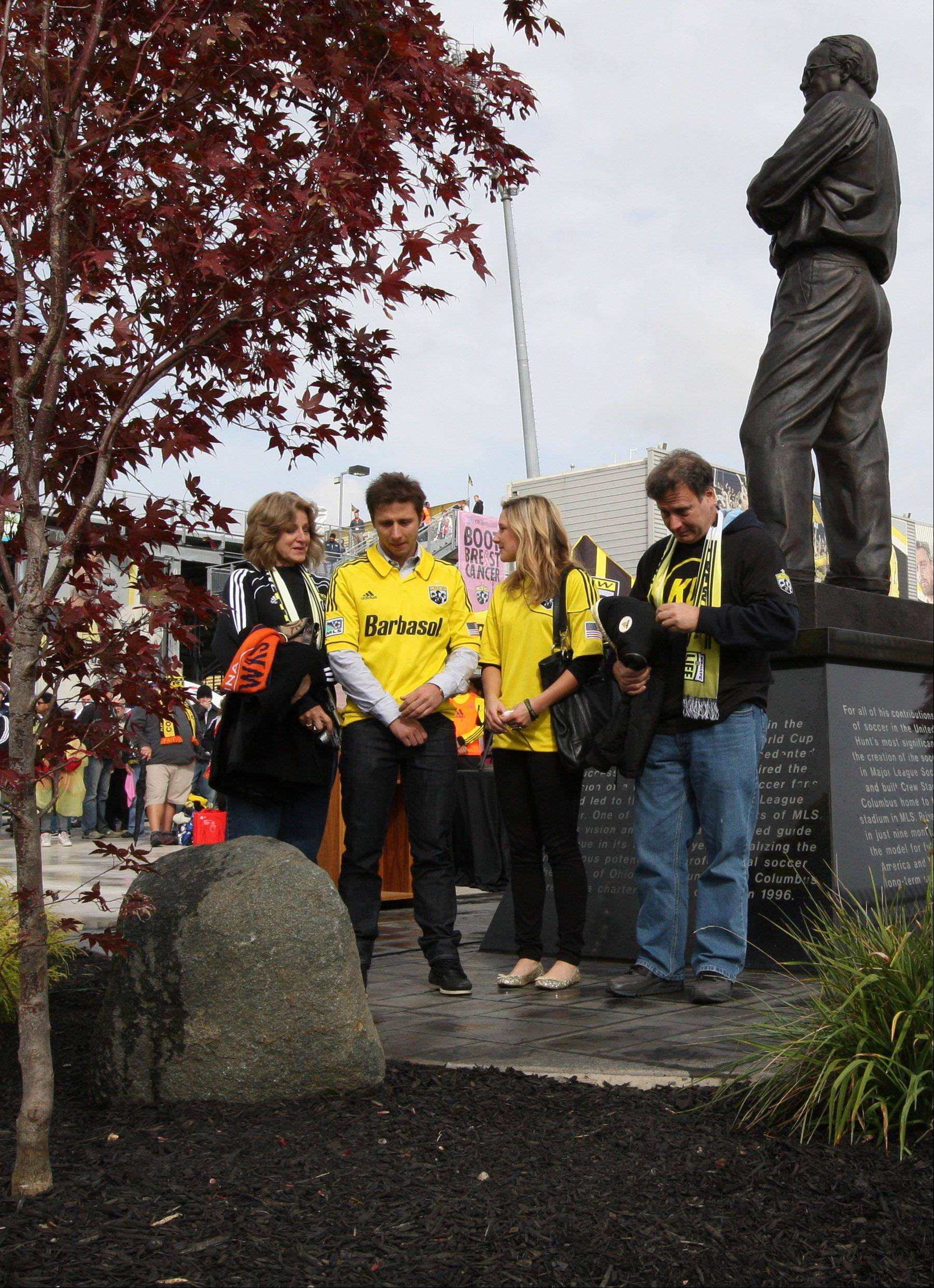 The Urso family Sandy, Kirk Urso's mother, Kyle (brother), Erica (Kyle's girlfriend) and Mike (father) stand under the shadow of the statue of Lamar Hunt as they read an inscription on a boulder dedicated Sunday to Columbus Crew player Kirk Urso during a ceremony at Founder's Park in the Crew Stadium. Kirk Urso of Lombard died suddenly on Aug. 5 of arrhythmogenic right ventricular cardiomyopathy at the age of 22.