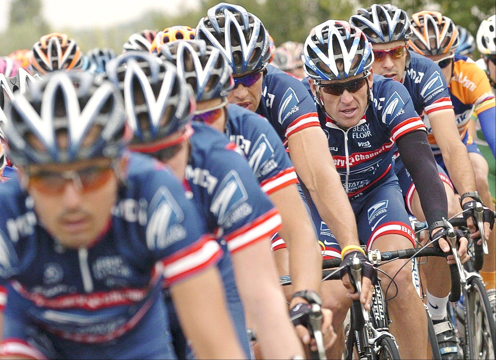 "This 2004 Tour de France photo shows U.S. Postal Service team leader Lance Armstrong, third from right, framed by his teammates. The U.S. Anti-Doping Agency says 11 of Lance Armstrong's former teammates testified against him in its investigation of the cyclist, revealing ""the most sophisticated, professionalized and successful doping program that sport has ever seen."""