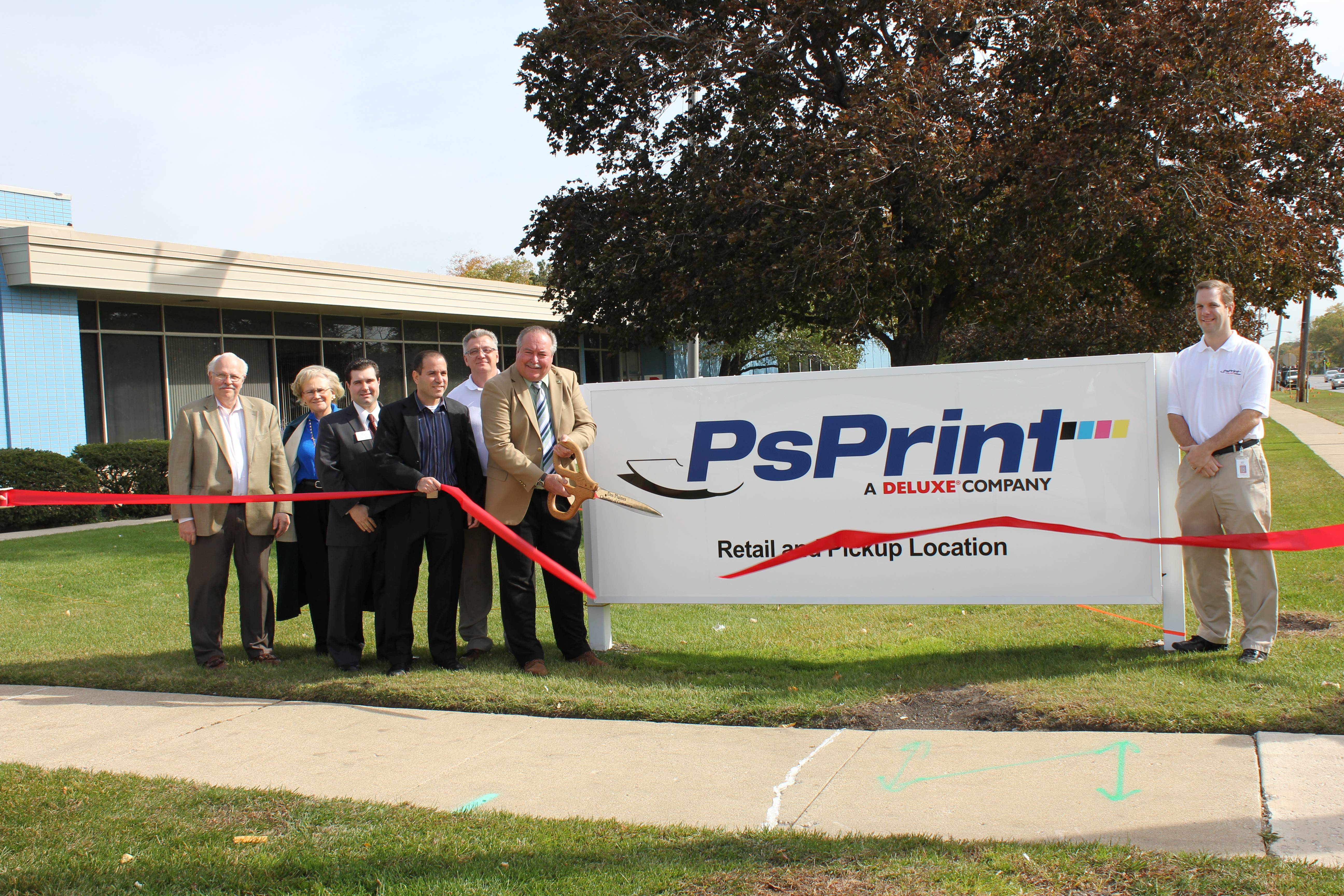 (pictured above left to right) John Koelig, Koelig & Associates, Donna Catlett, Mayor's Office, Marty Gardner, Village Bank & Trust, Illan Sasson, Vice President Operations, Deluxe Corp., Randy Kmieciak, PsPrint, 6th Ward Alderman Mark Walsten, and Rich Appenzeller, PsPrint, pose for a photograph in front of PsPrint, 1600 E. Touhy Avenue, as the ribbon is cut marking the grand opening.