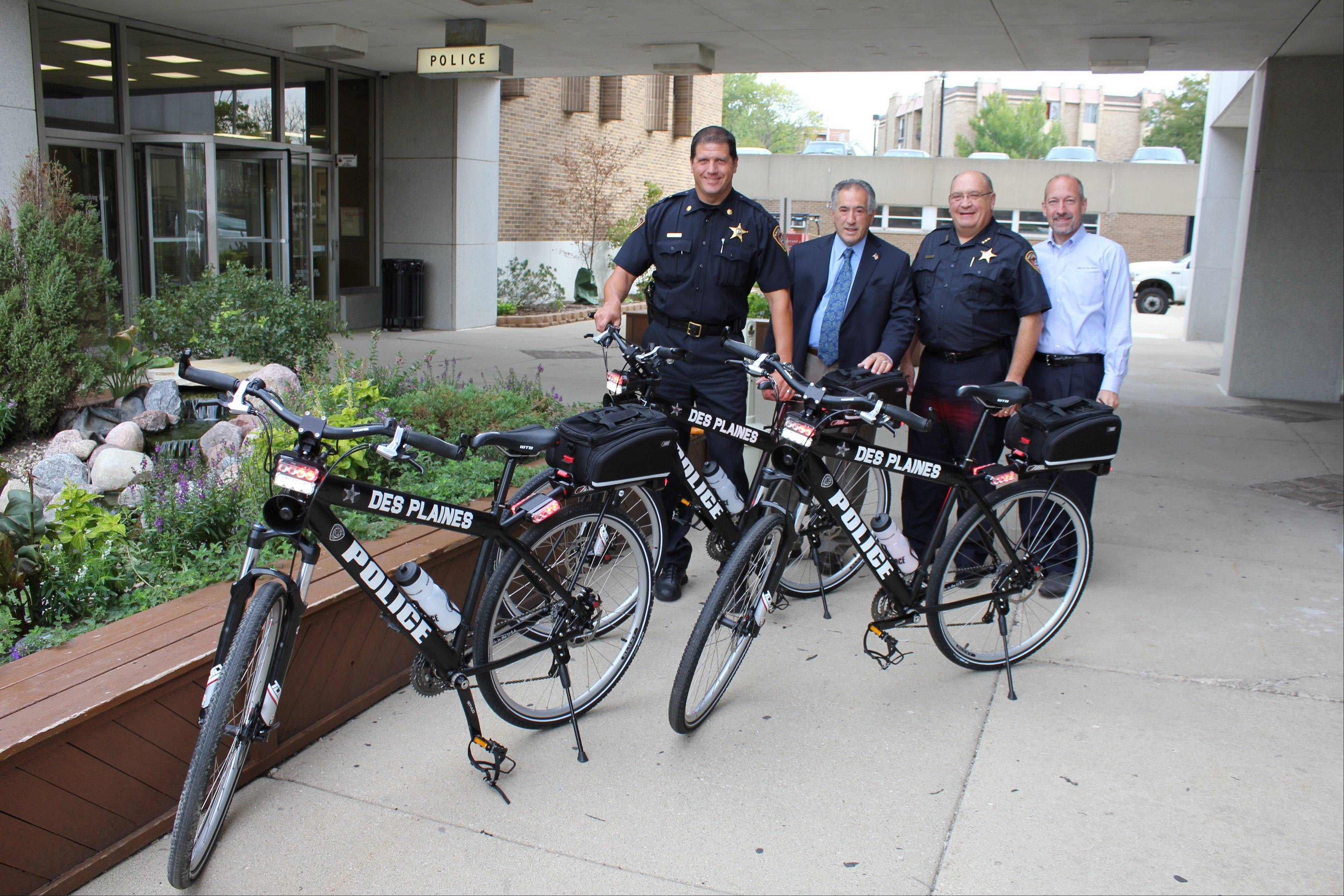 The Des Plaines Police Department displayed four new iForce bicycles outside the police station on Miner Street. Pictured, from left, are Des Plaines Police Commander Dan Niemann, Mayor Martin J. Moylan, police Chief William Kushner, and City Manager Michael Bartholomew with the new bicycle fleet.