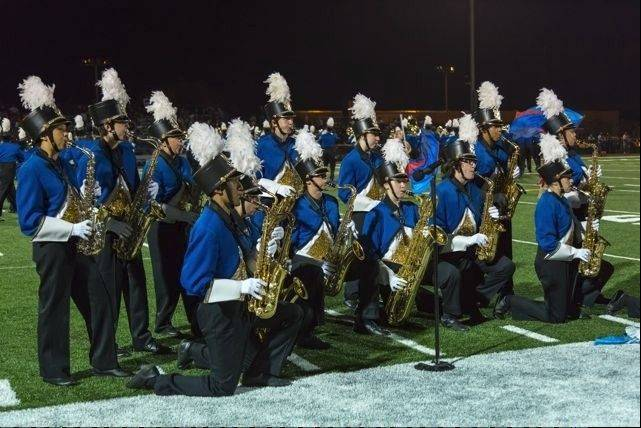 The Wheeling High School Wildcat Marching Band performs during a 2012 football game.