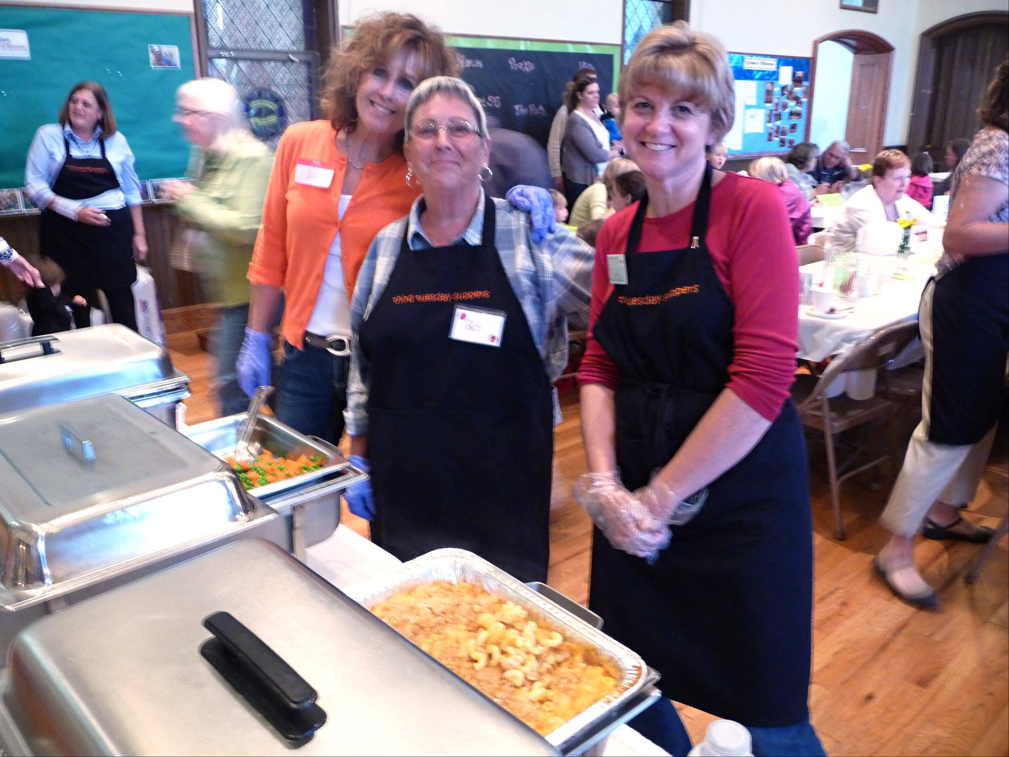 Sue Sanders, Pat Dallesasse and Debbie Karr are ready to serve guests at a recent Third Tuesday Supper in Geneva.