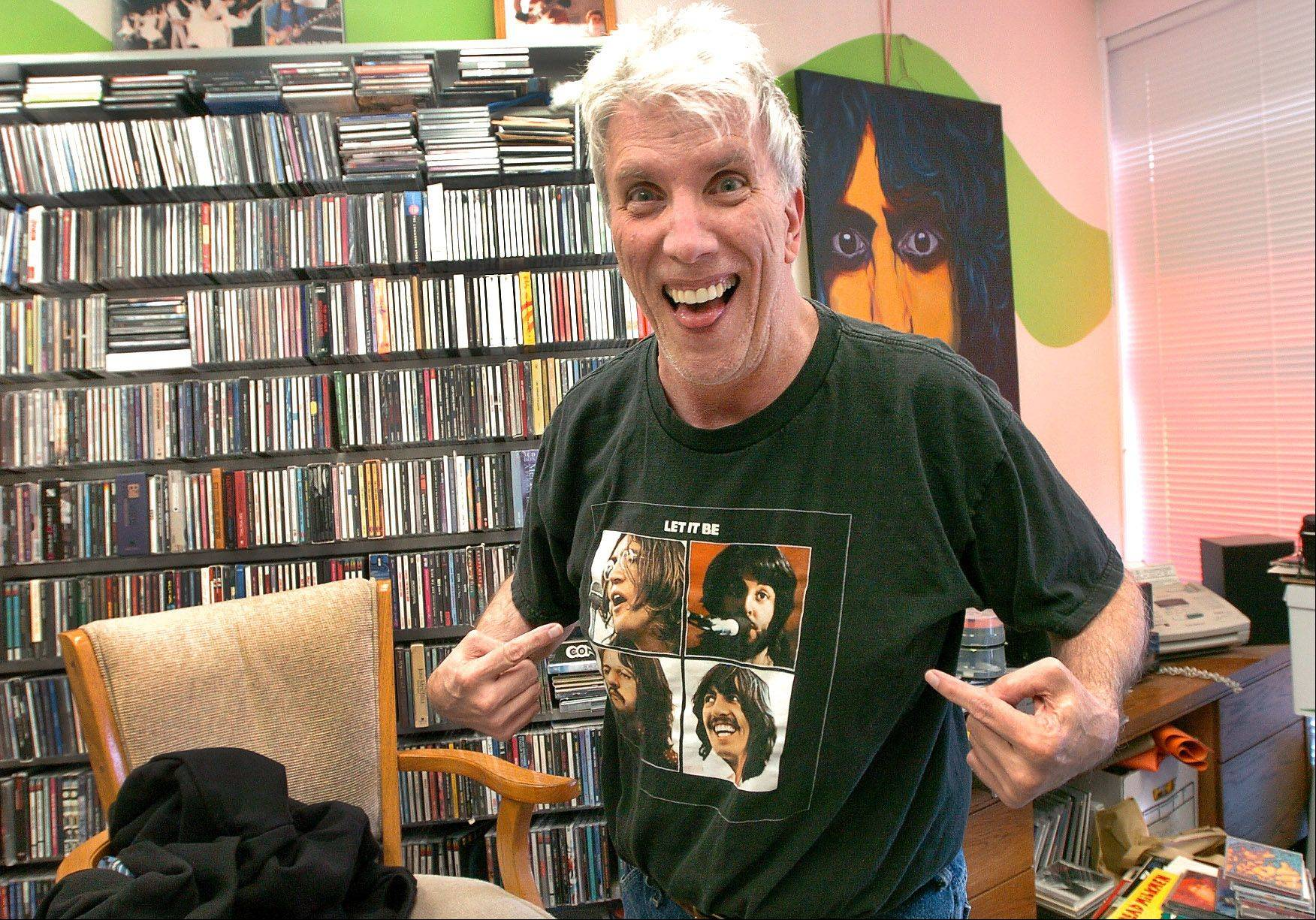 John Thominet, owner of Rainbow Records in Barrington, sports a Beatles shirt.