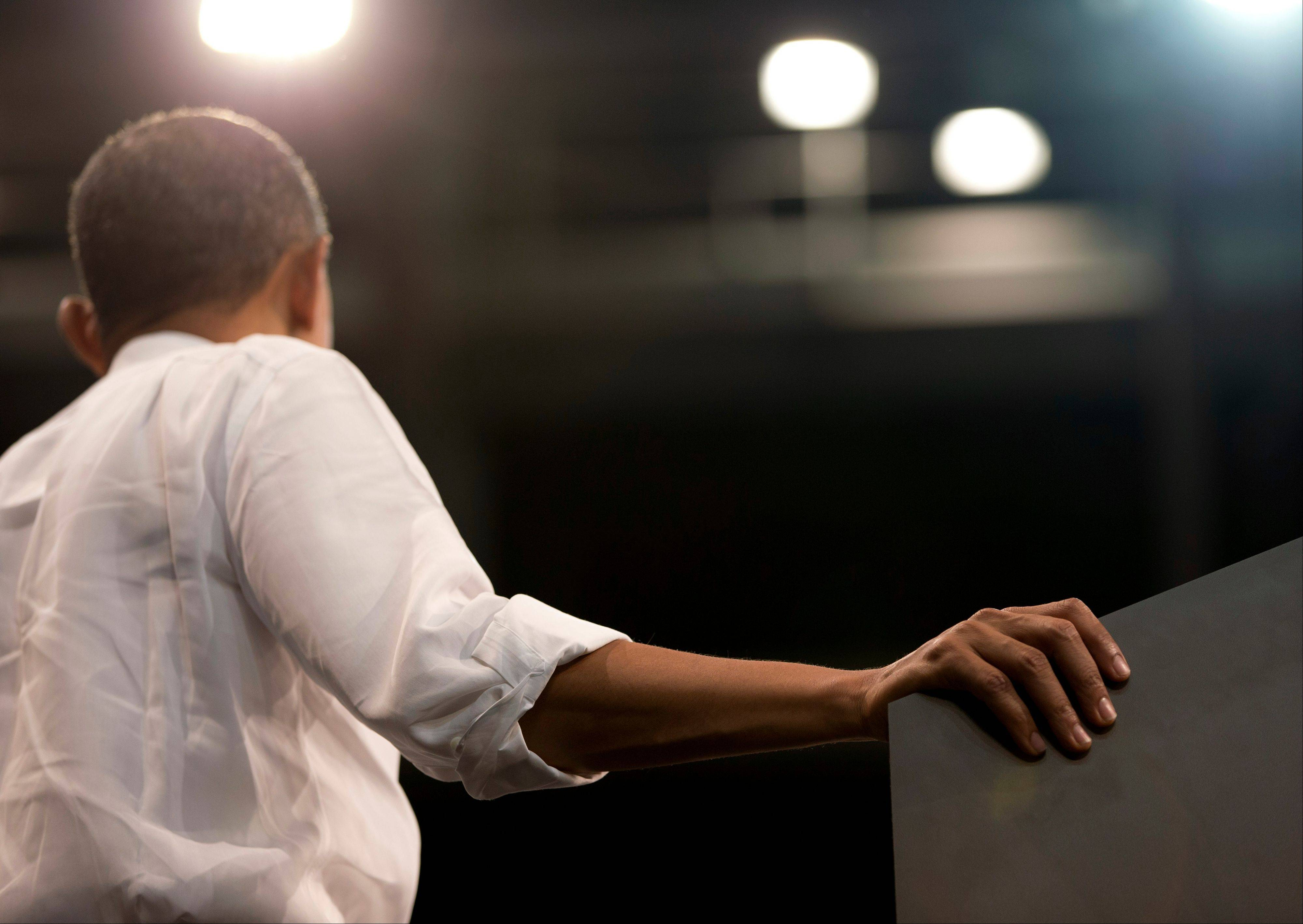 President Barack Obama rests his hand on the podium as he speaks at a campaign event at the University of Miami, Thursday, Oct. 11, 2012, in Coral Gables, Fla.