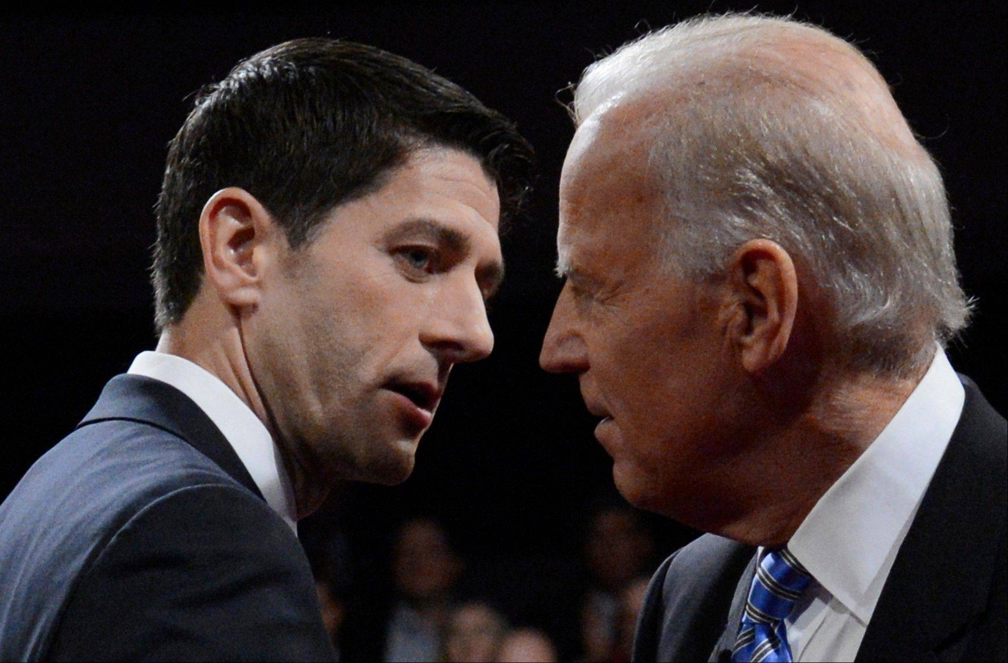 Vice President Joe Biden and Republican vice presidential nominee Rep. Paul Ryan of Wisconsin shake hands after the vice presidential debate at Centre College.