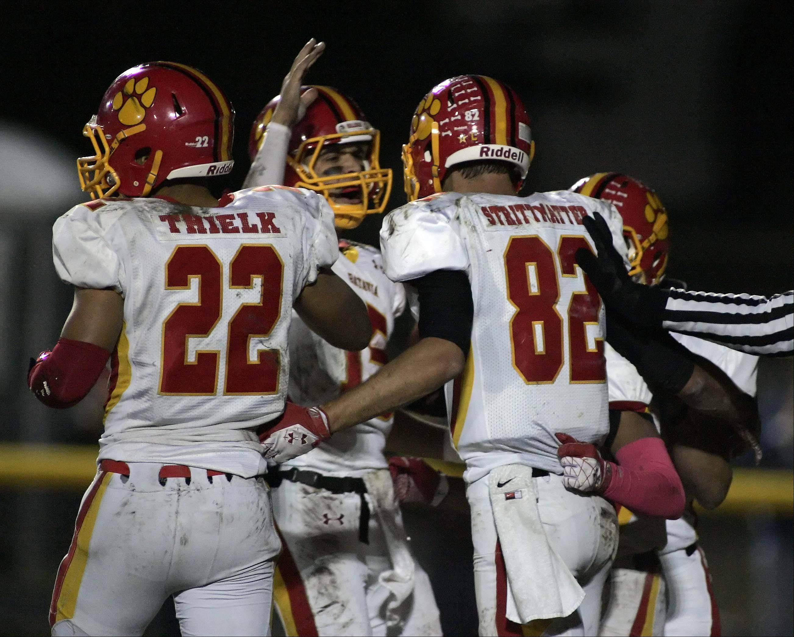 Batavia�s Zachary Strittmatter (82) is greeted by his teammates after a touchdown in the second quarter at St. Charles East Friday.