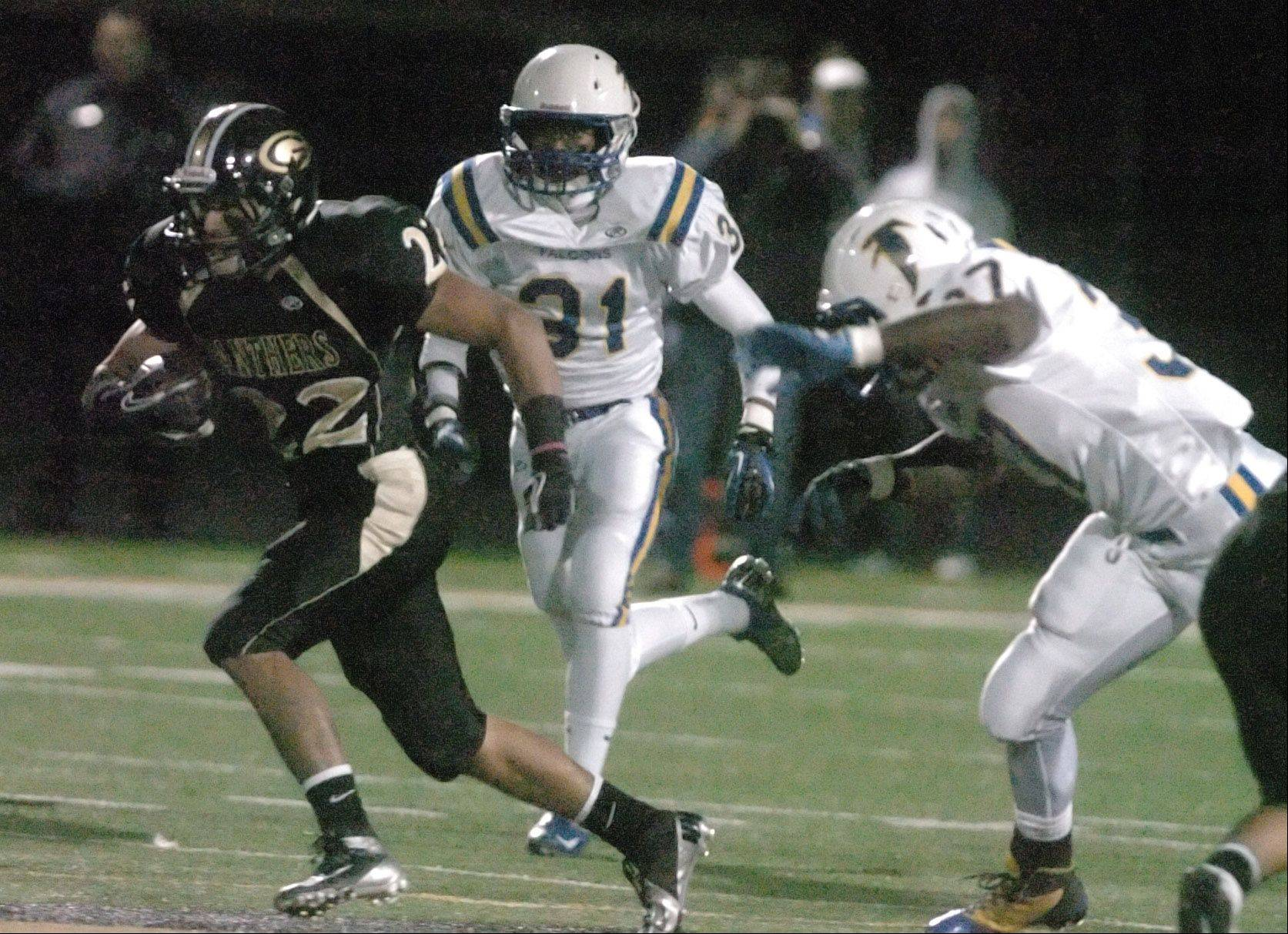 Mario Rodriguez of Glenbard North is pursued by Wheaton North defenders.