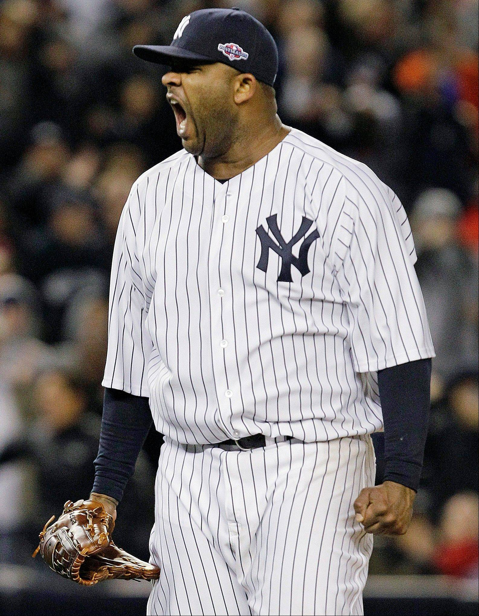 New York Yankees starting pitcher CC Sabathia reacts Friday after Baltimore Orioles shortstop J.J. Hardy grounded out to end the eighth inning of Game 5 of the American League division baseball series in New York. The Yankees won the game 3-1.