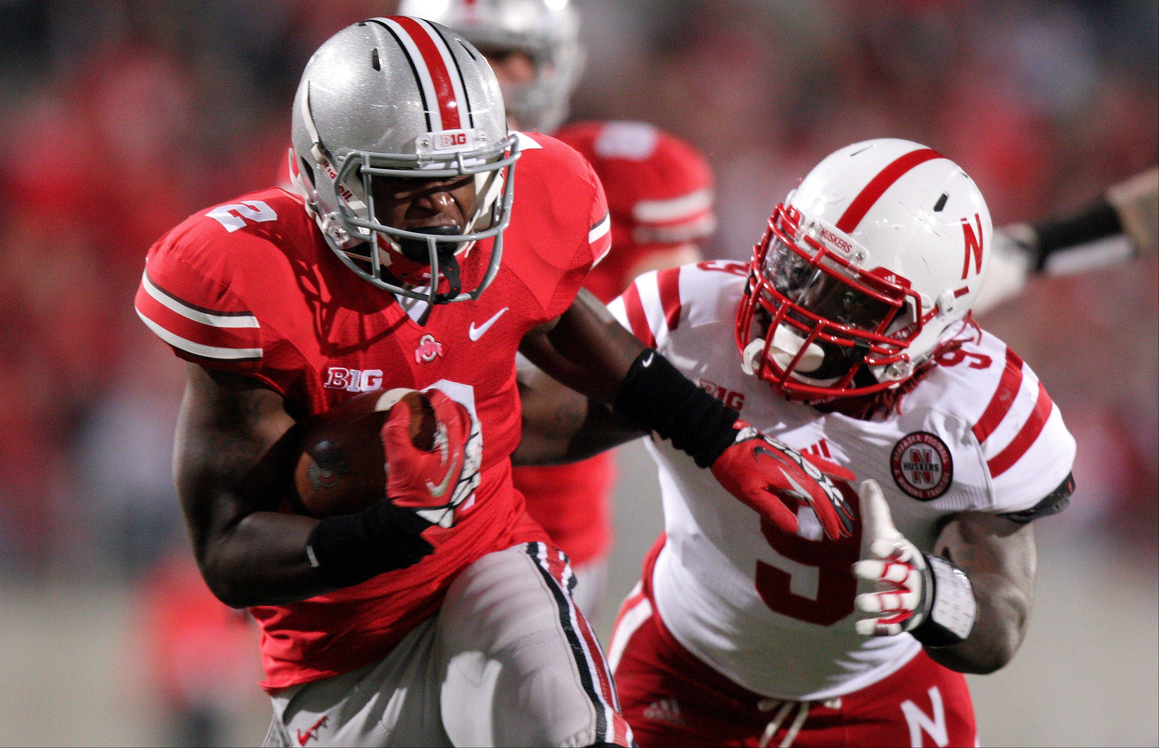 Ohio State running back Rod Smith outruns Nebraska's Jason Ankrah on his way to a touchdown during the fourth quarter last Saturday in Columbus, Ohio.