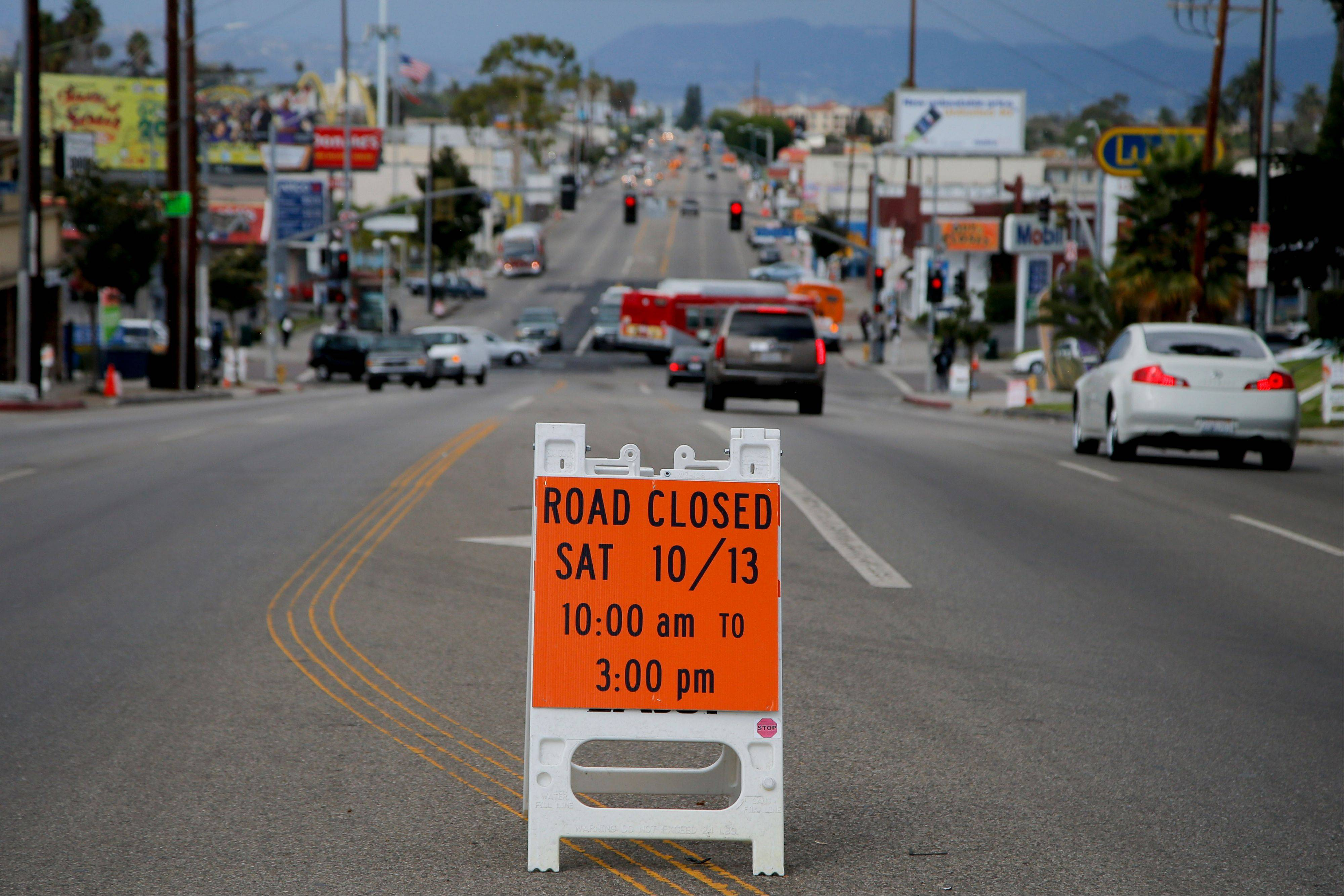 A sign advising the street closure on Crenshaw Boulevard prior to the transfer of the space shuttle Endeavour in Inglewood, Calif.